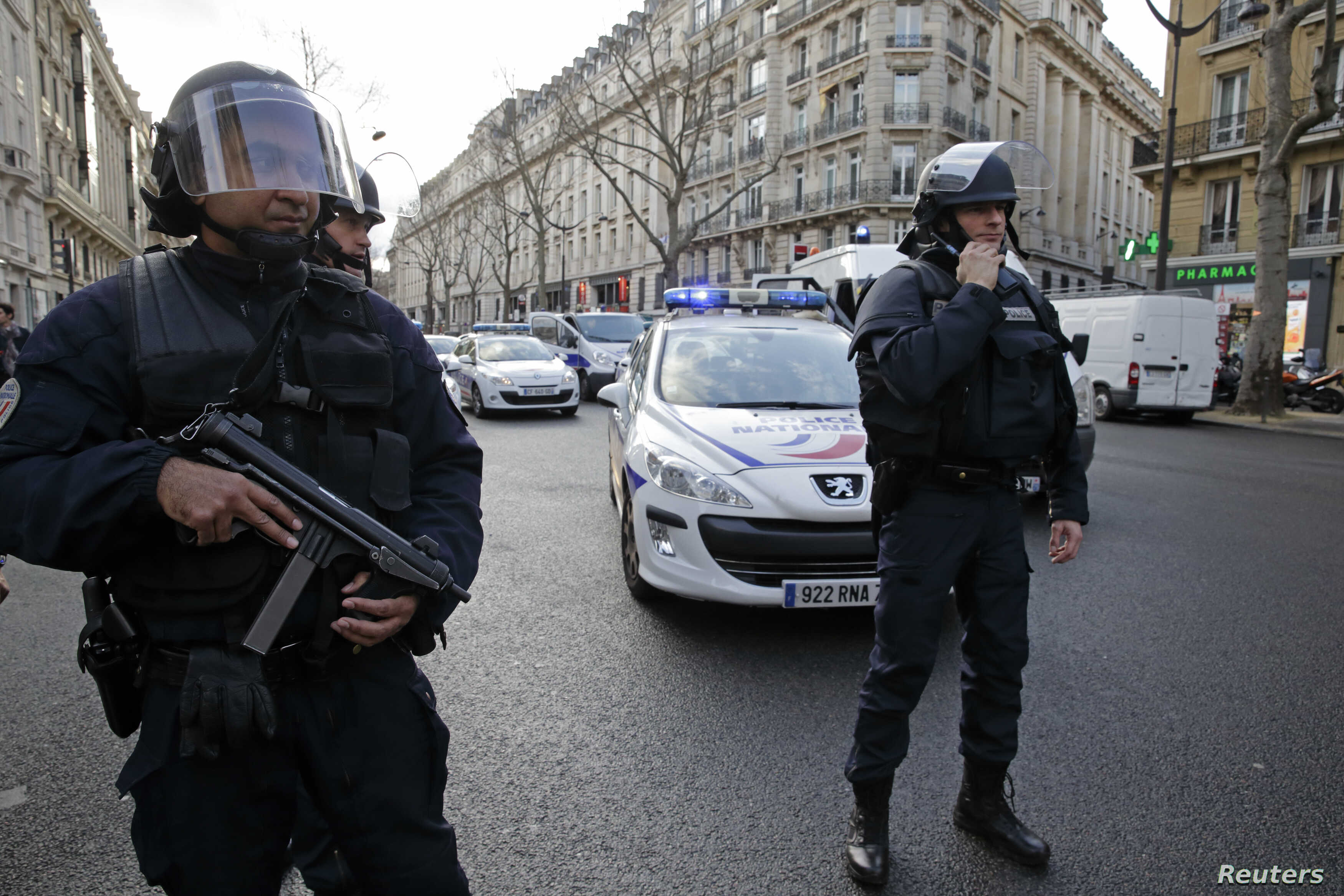 French riot police block the avenue Kleber after an alert in Paris, Jan. 9, 2015.