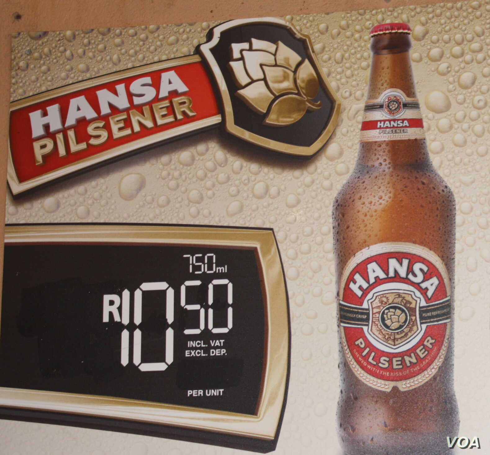 A sign in a tavern, or shebeen, advertises a 750 ml quart of a popular South African beer for the equivalent of less than a dollar. (D. Taylor/VOA)