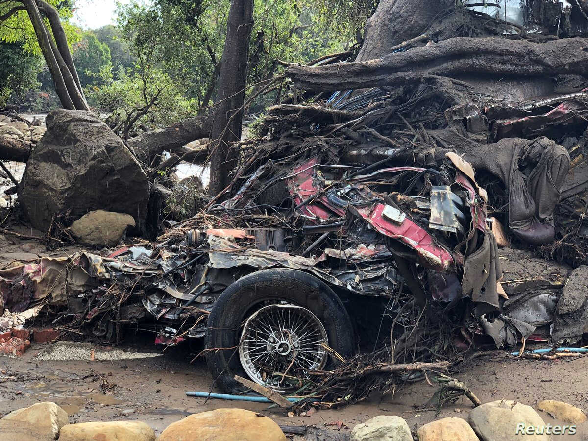 Parts of a damaged car are entangled in debris after mudslides in Montecito, California, U.S. in this photo provided by the Santa Barbara County Fire Department, Jan. 9, 2018.
