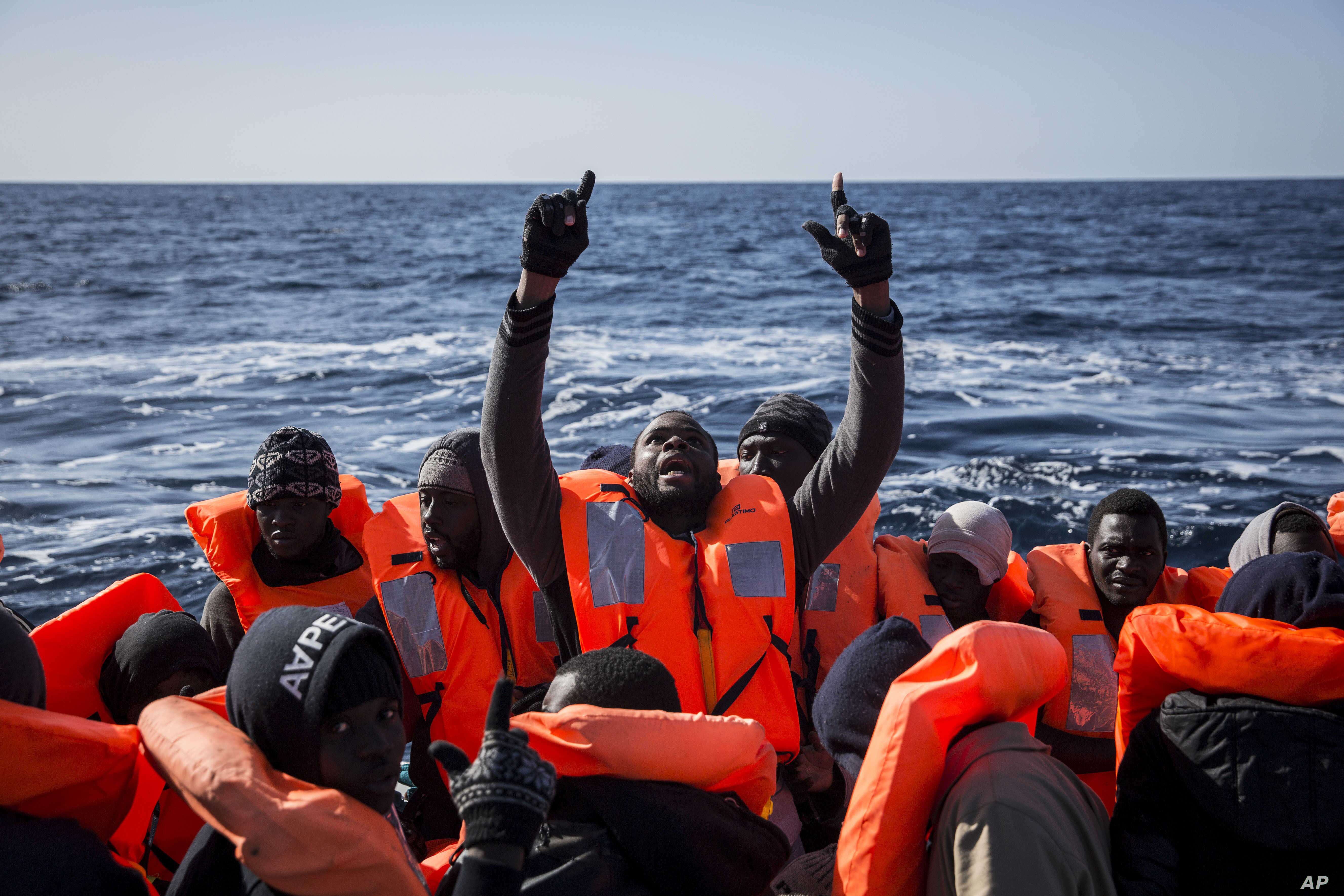 FILE - Sub-Saharan migrants are rescued by members of Proactiva Open Arms NGO at the Mediterranean sea, about 20 miles north of Ra's Tajura, Libya, Jan. 12, 2017. About 300 migrants were rescued Tuesday from three dinghies by members of Proactiva and...