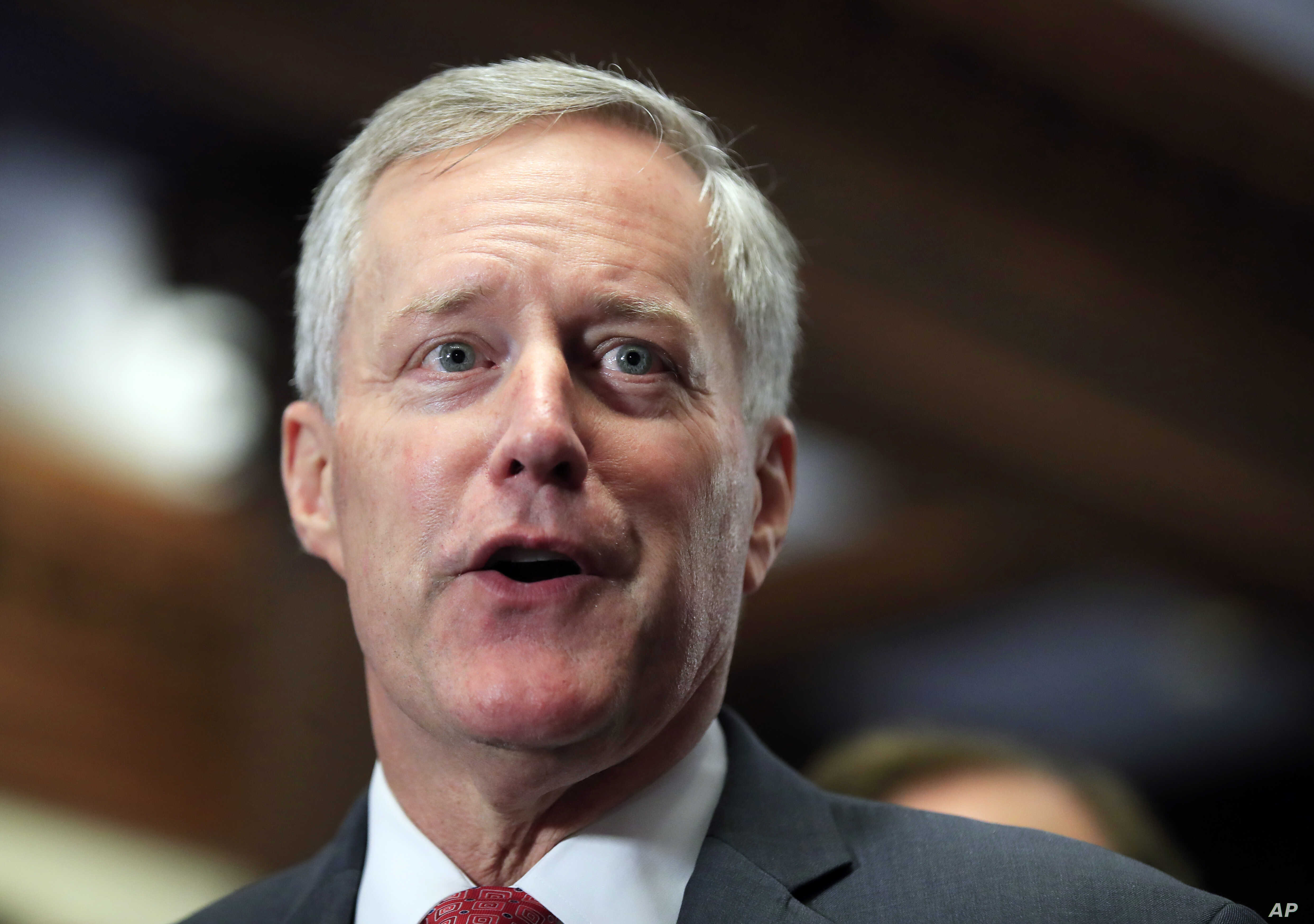 "FILE - Freedom Caucus Chairman Rep. Mark Meadows, R-S.C., speaks to reporters on Capitol Hill in Washington. Divisions over whether to provide a conduit to citizenship for young ""Dreamer"" immigrants brought to the U.S. illegally loom as the pivot..."