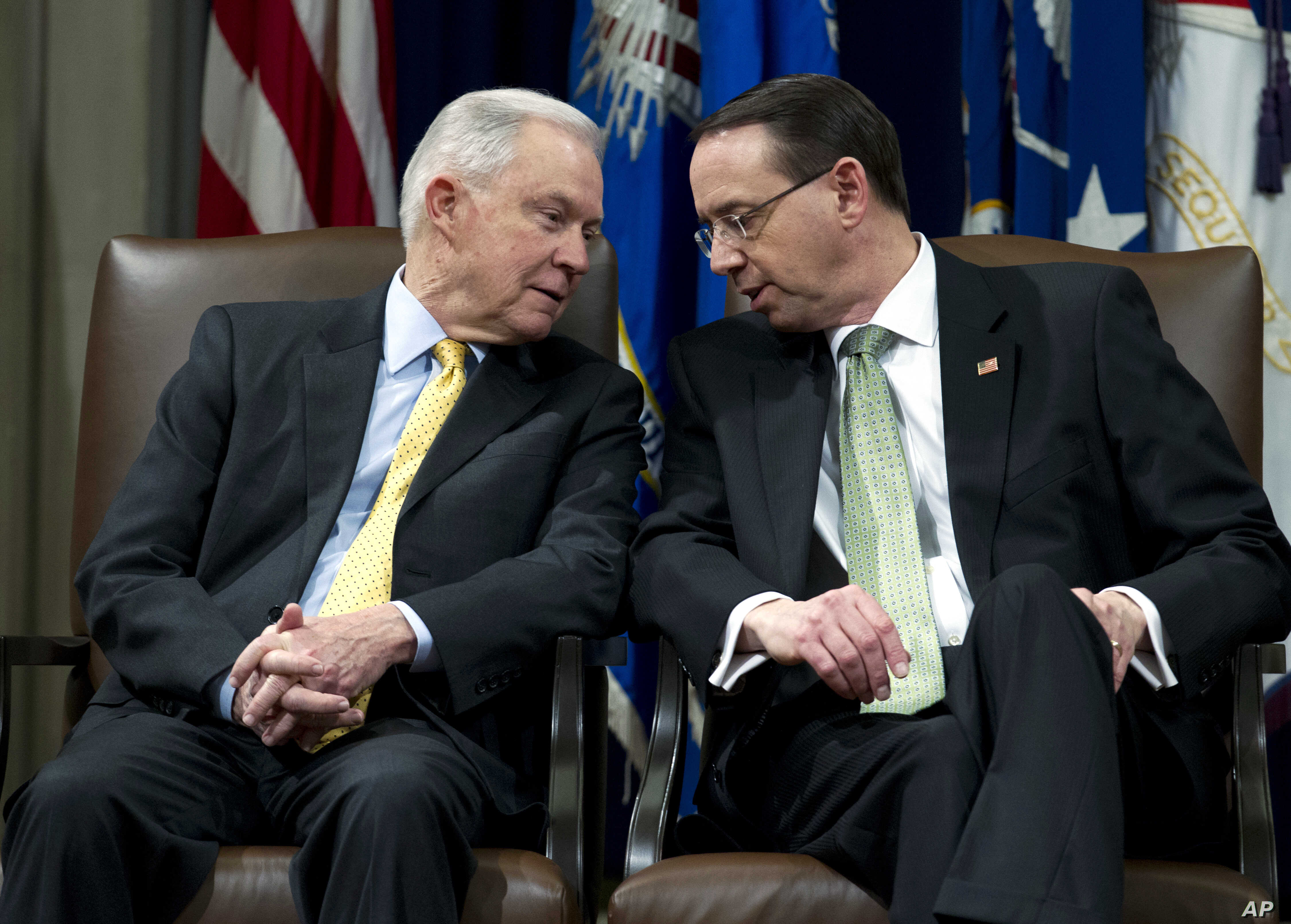 Attorney General Jeff Sessions speaks with Deputy Attorney General Rod Rosenstein, during the opening of the summit on Efforts to Combat Human Trafficking at Department of Justice in Washington, Feb. 2, 2018.