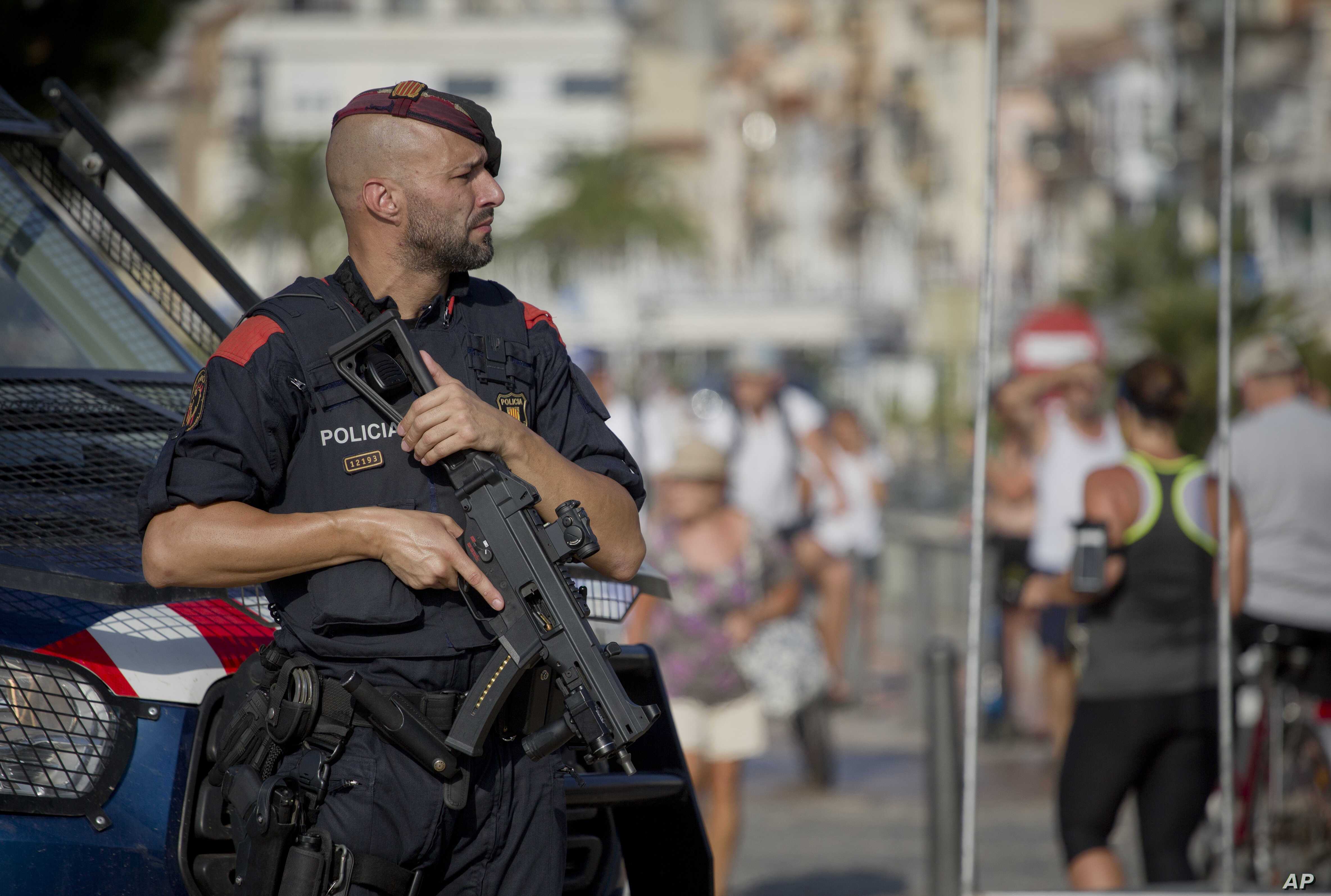 An armed policeman stands on the spot where terrorist were shot by police in Cambrils, Spain, Aug. 18, 2017.