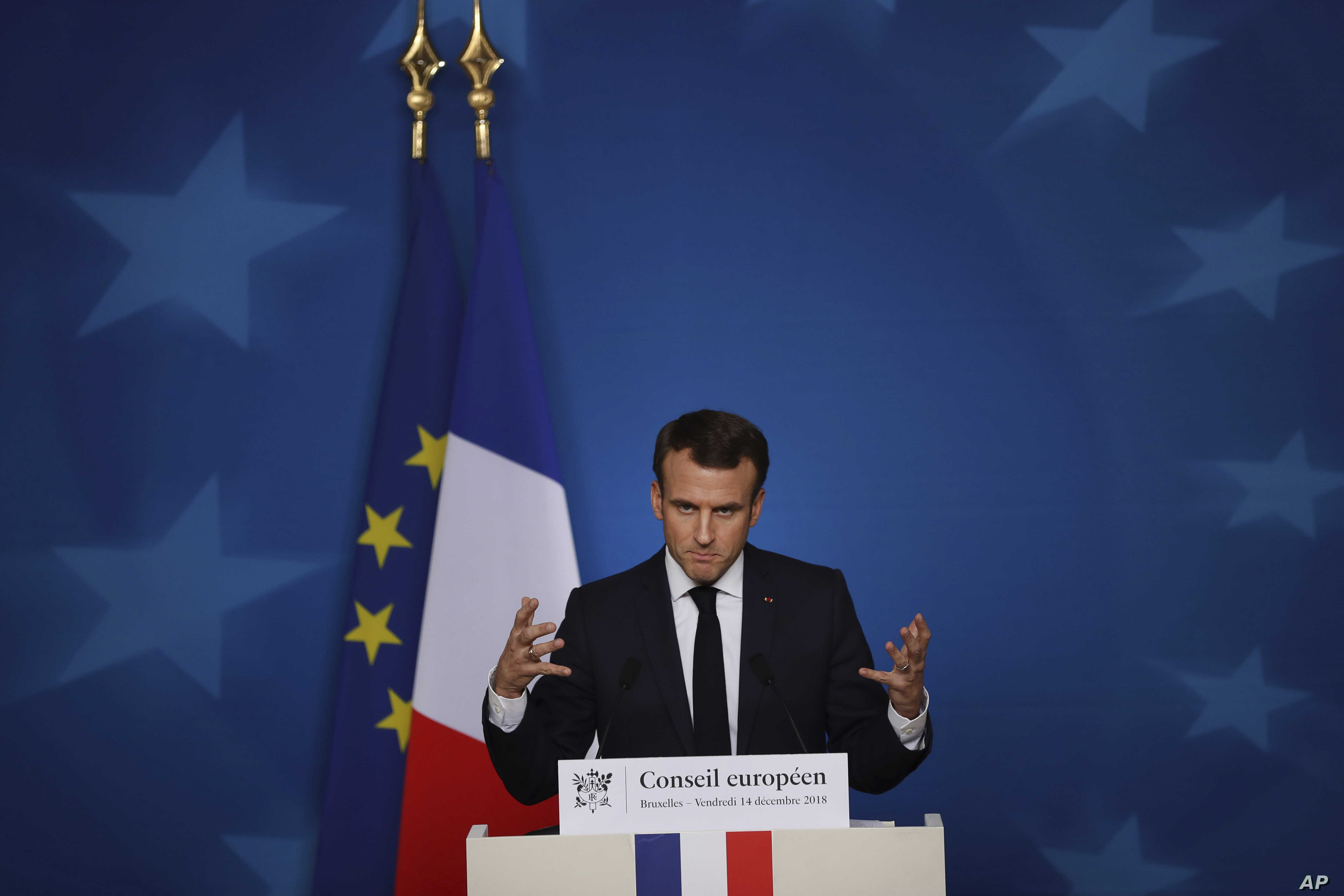 French President Emmanuel Macron speaks during a media conference during an EU summit in Brussels, Dec. 14, 2018.