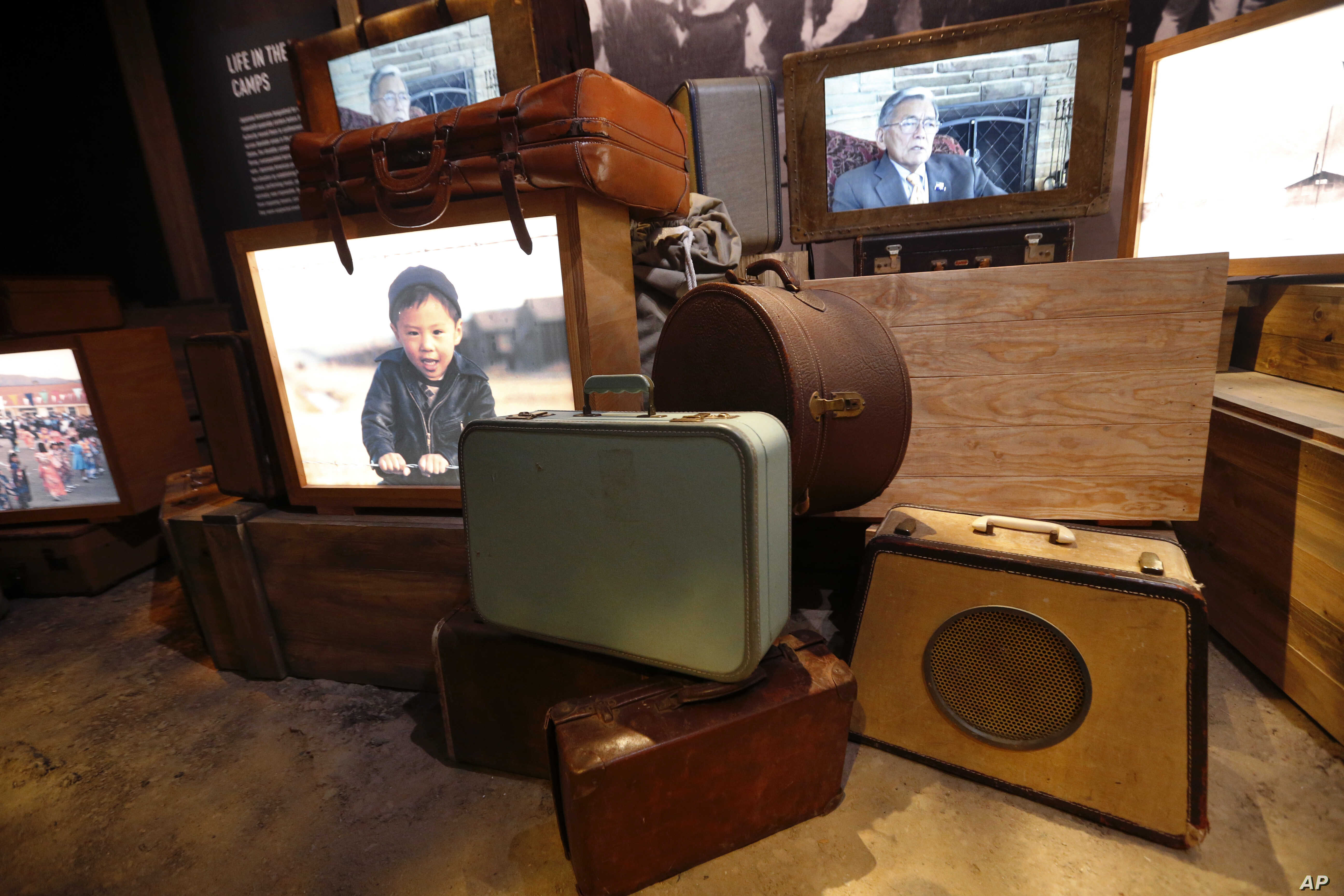 "Luggage, an image of a boy of Japanese descent, and a video interview of a man who was kept in an internment camp, are part of the permanent exhibit ""Salute to the Home Front"" at the National World War II Museum."