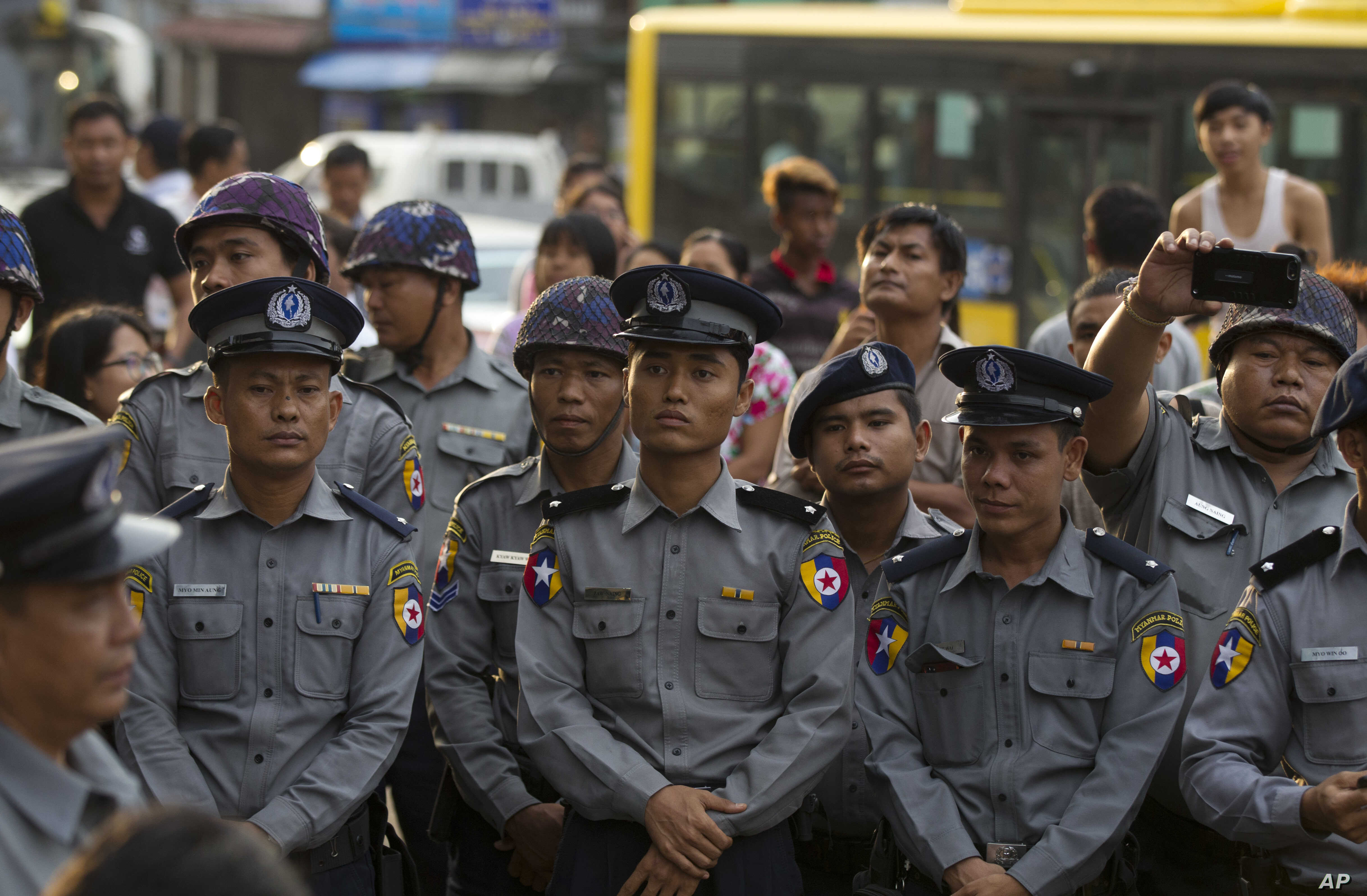 FILE - Riot police stand in position to block activists during a rally for peace, May 12, 2018, in Yangon, Myanmar.