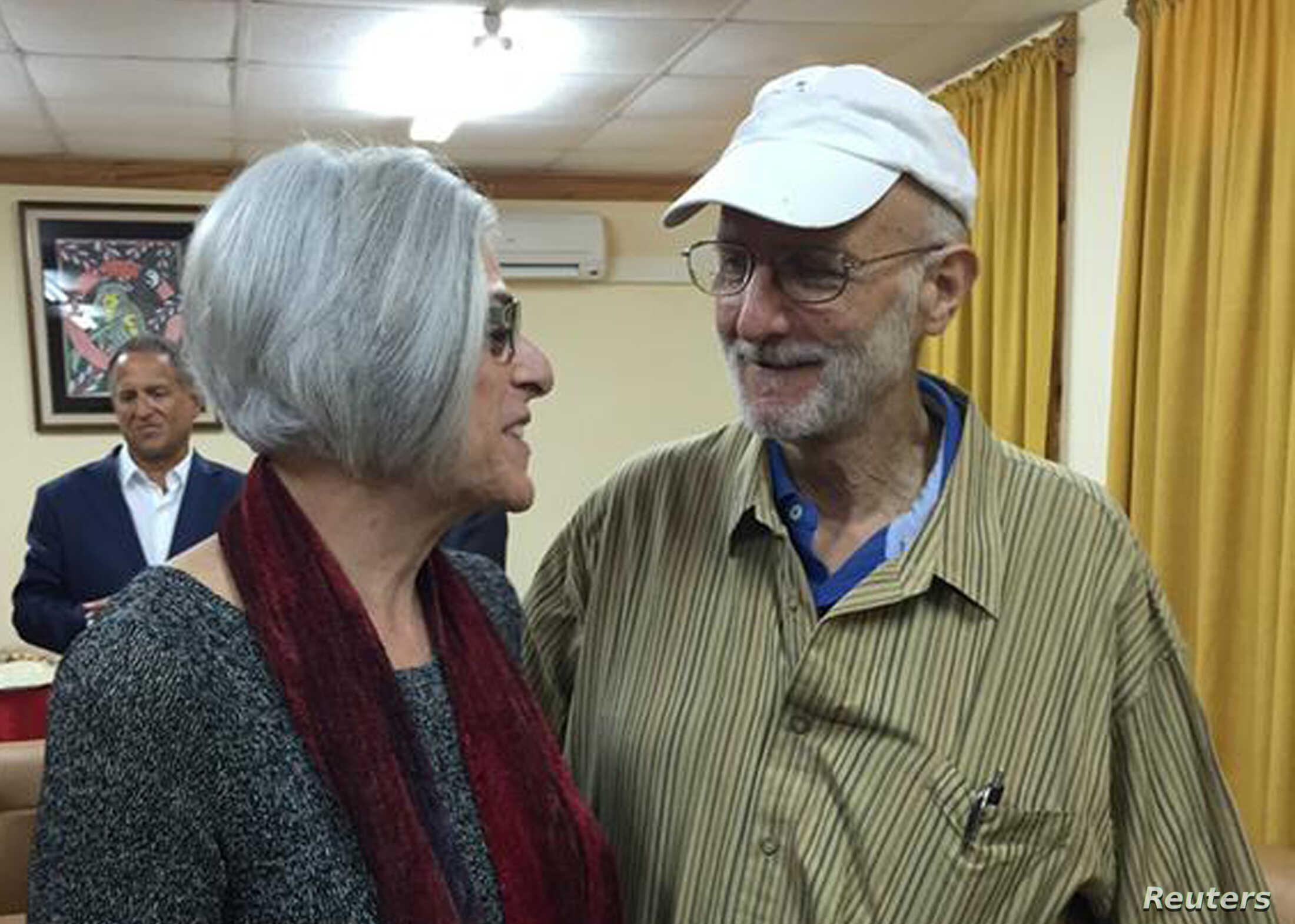American aid worker Alan Gross (R) speaks with his wife Judy shortly before leaving Havana on December 17, 2014 in this photo tweeted by U.S. Sen. Jeff Flake (R-AZ). U.S. President Barack Obama was set to announce a shift in policy toward Cuba on Wed...