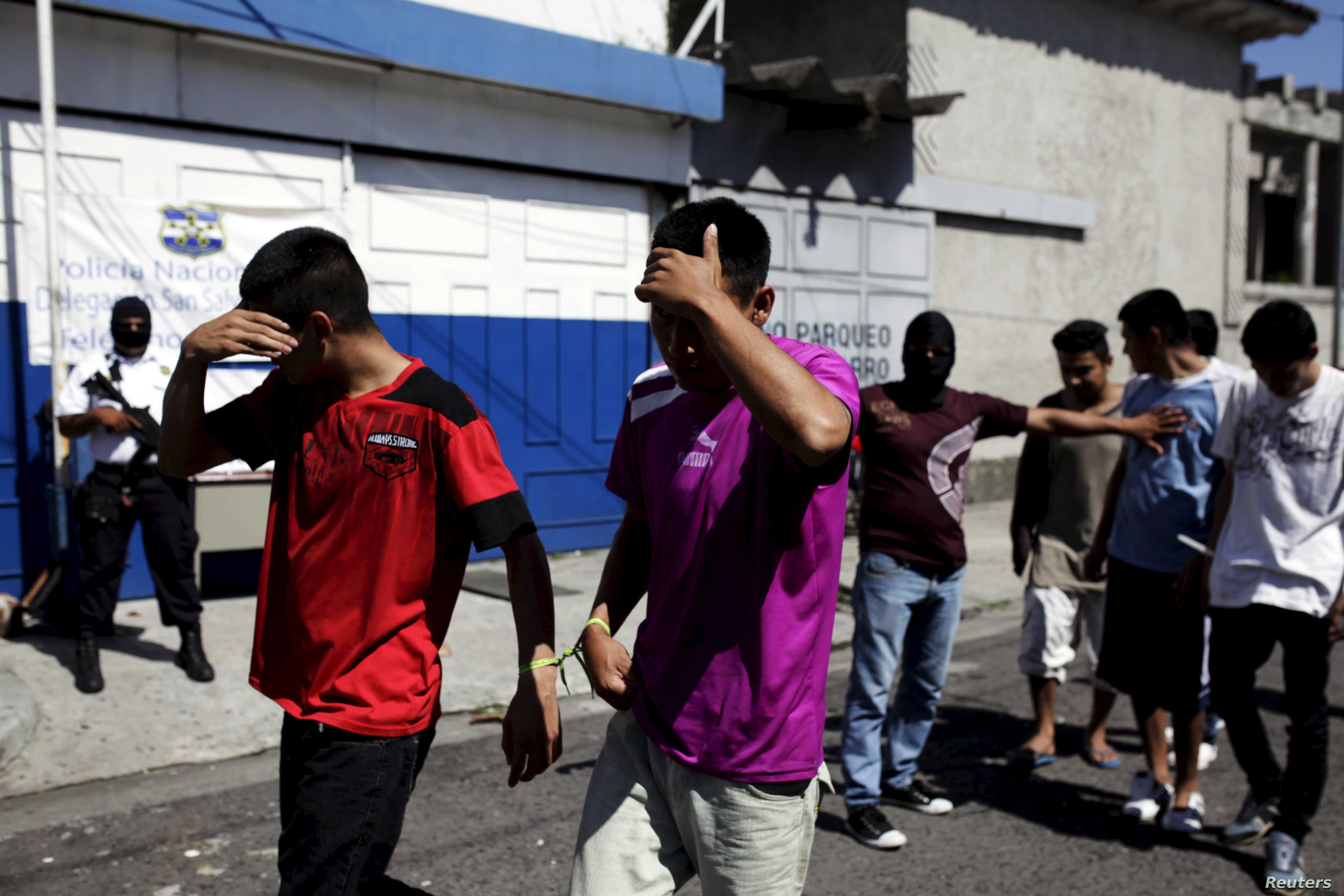 Suspected members of the 18th Street gang are presented to the media after they were arrested in a raid in San Salvador, El Salvador, Aug. 19, 2015.