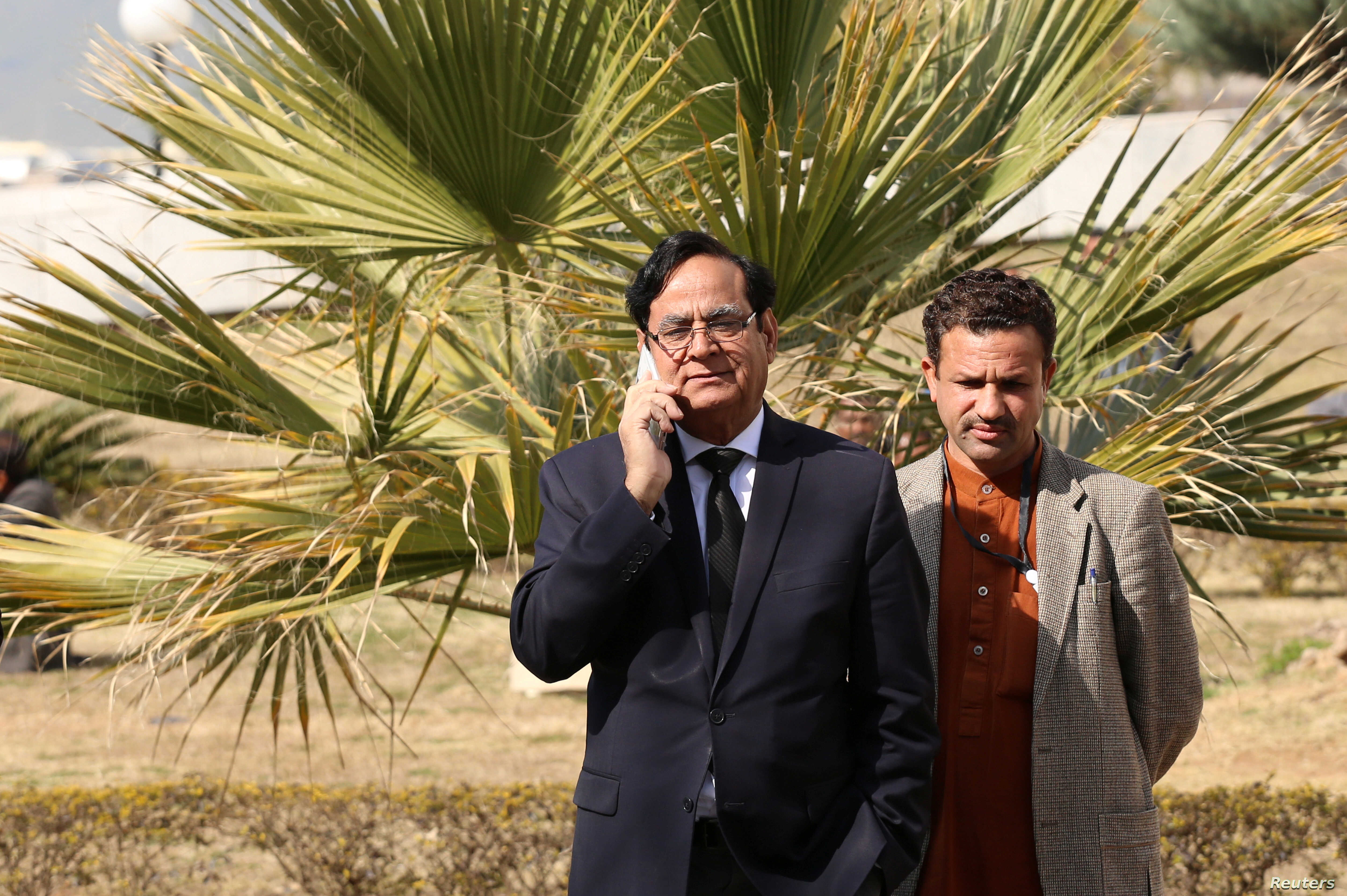 Saiful Mulook (L), lawyer for Asia Bibi, a Pakistani Christian acquitted of capital blasphemy charges, talks on a mobile phone at the premises of the Supreme Court in Islamabad, Jan. 29, 2019.