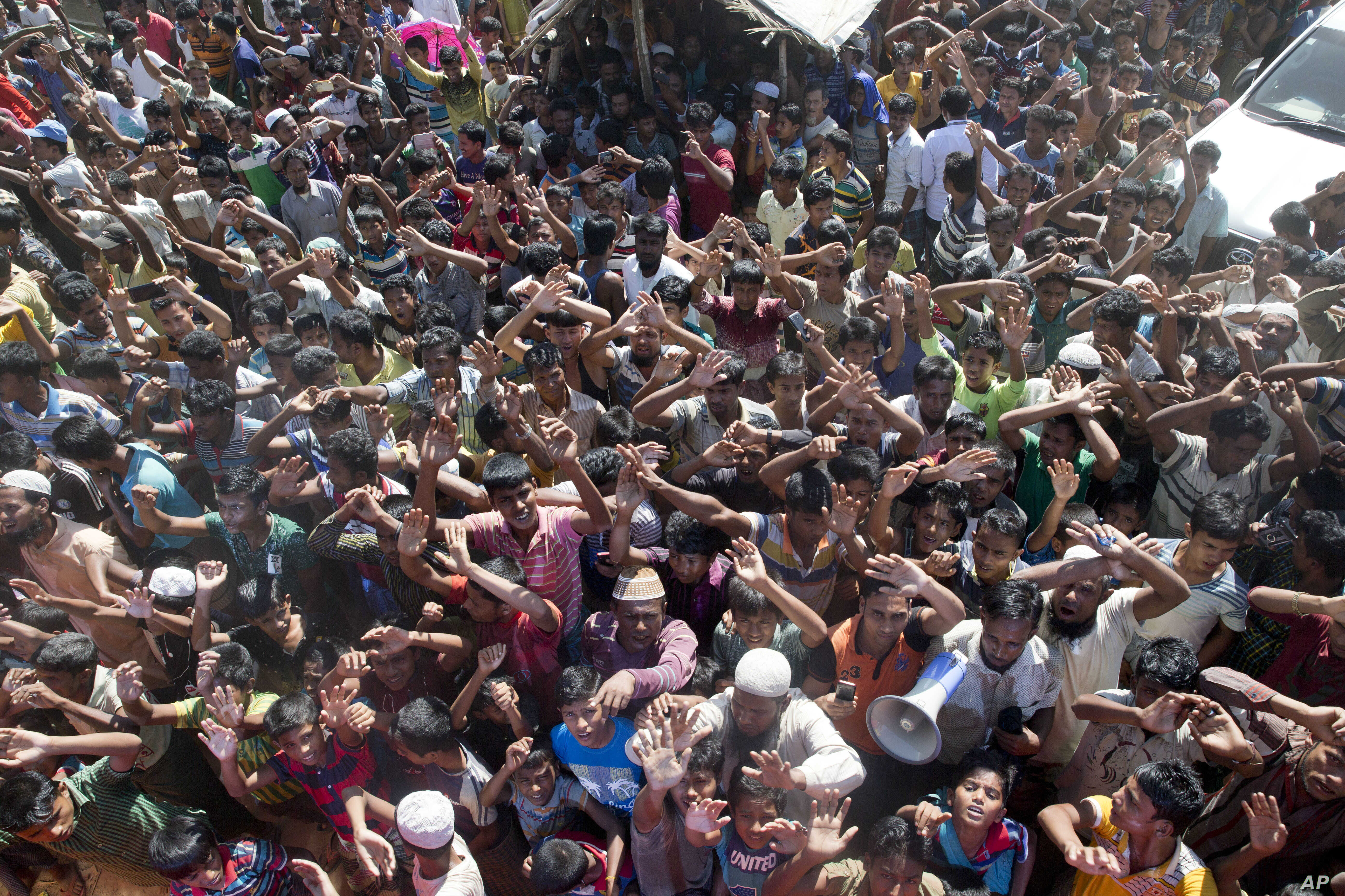 Rohingya refugees shout slogan during a protest against the repatriation process at Unchiprang refugee camp near Cox's Bazar, in Bangladesh, Nov. 15, 2018.