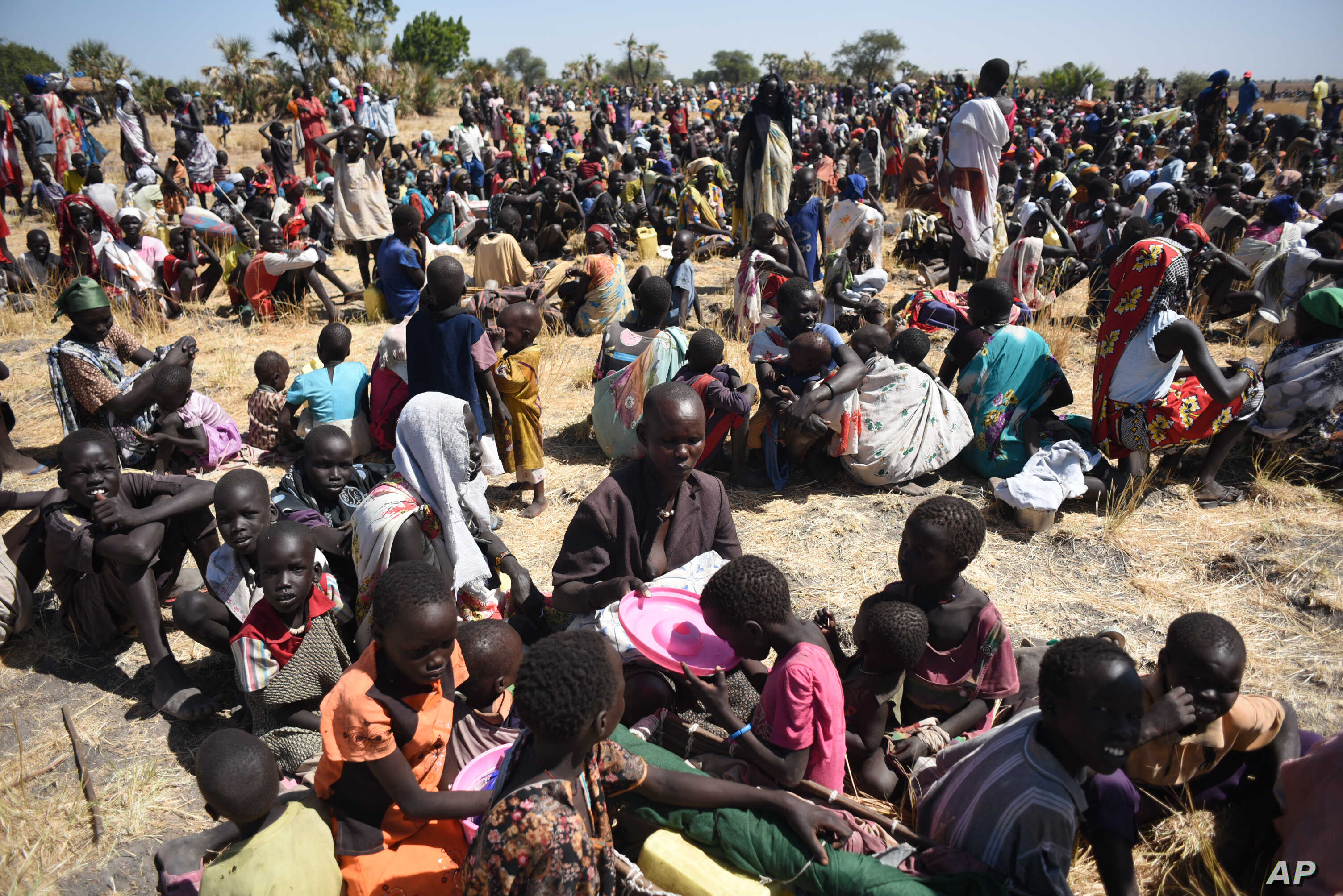 Some of more than 30,000 people who flocked into Leer town, South Sudan, to receive food from the International Committee of the Red Cross, Dec. 15, 2015, which marks the two-year anniversary of South Sudan's civil war.