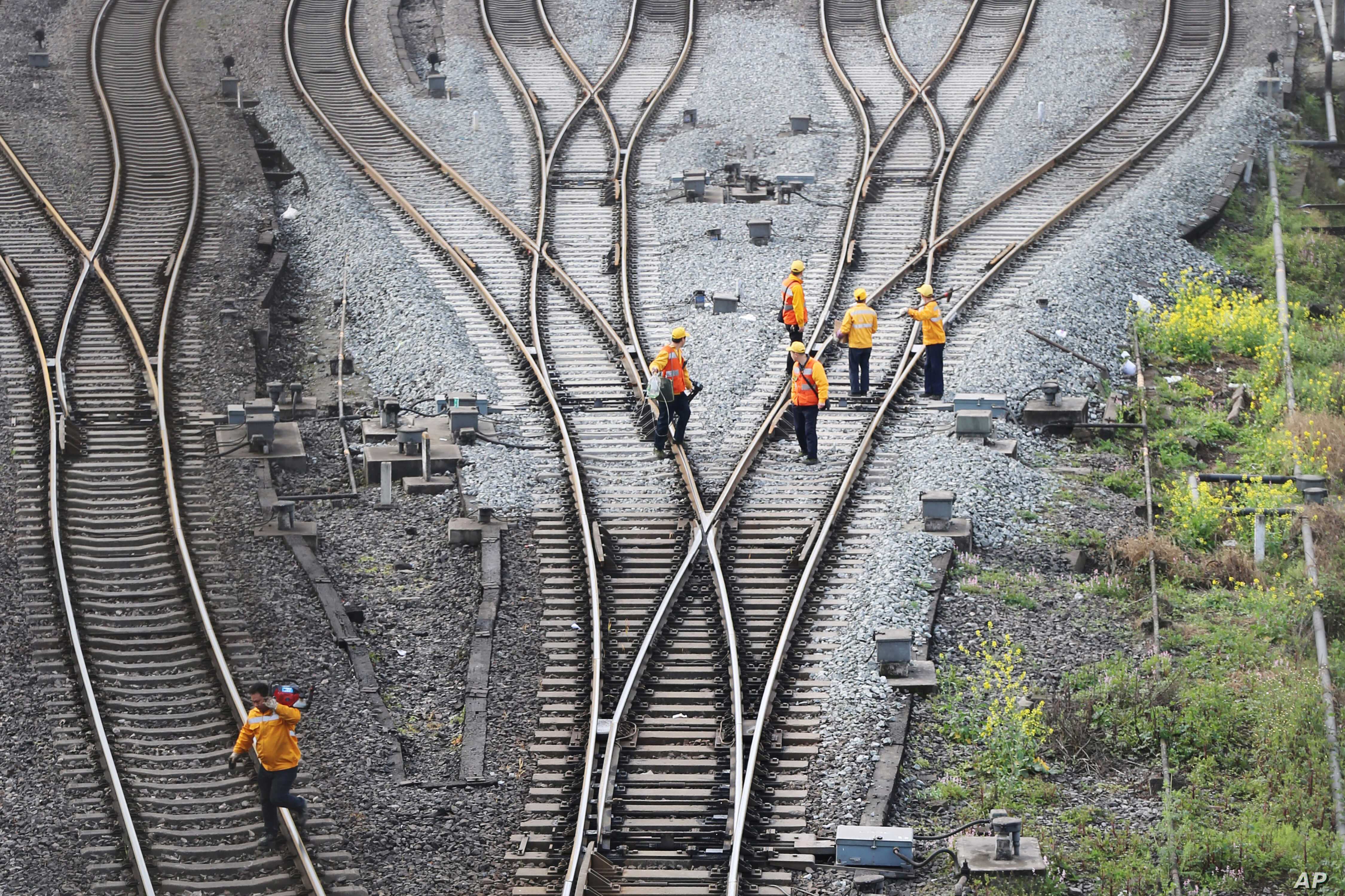 Workers inspect railway tracks, which serve as a part of the Belt and Road freight rail route linking Chongqing to Duisburg, at Dazhou railway station in Sichuan province, China, March 14, 2019.