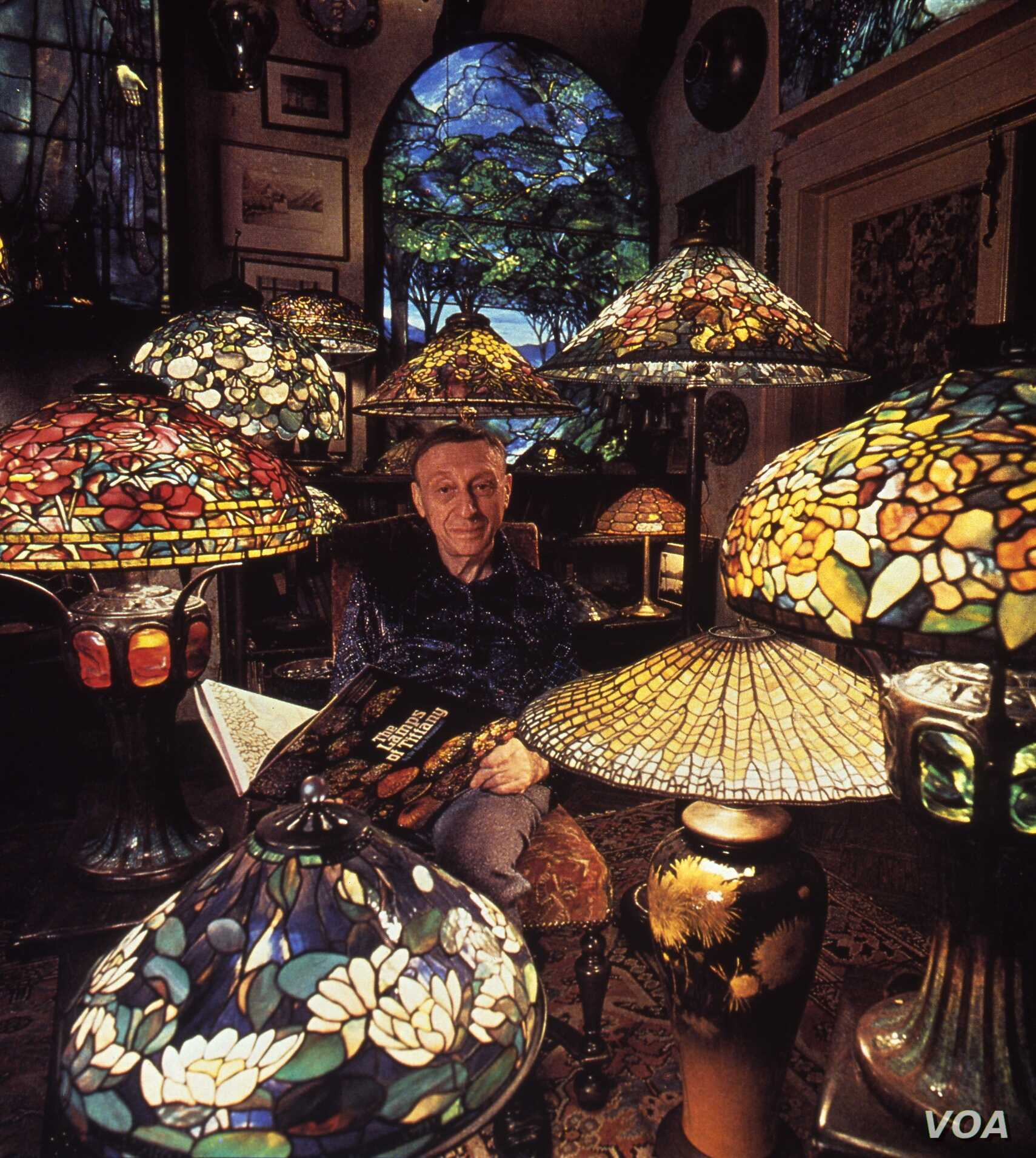 """Dr. Egon Neustadt among his Tiffany lamps, installed in his """"apartment-museum,"""" originally located in his townhouse on New York's Upper East Side."""