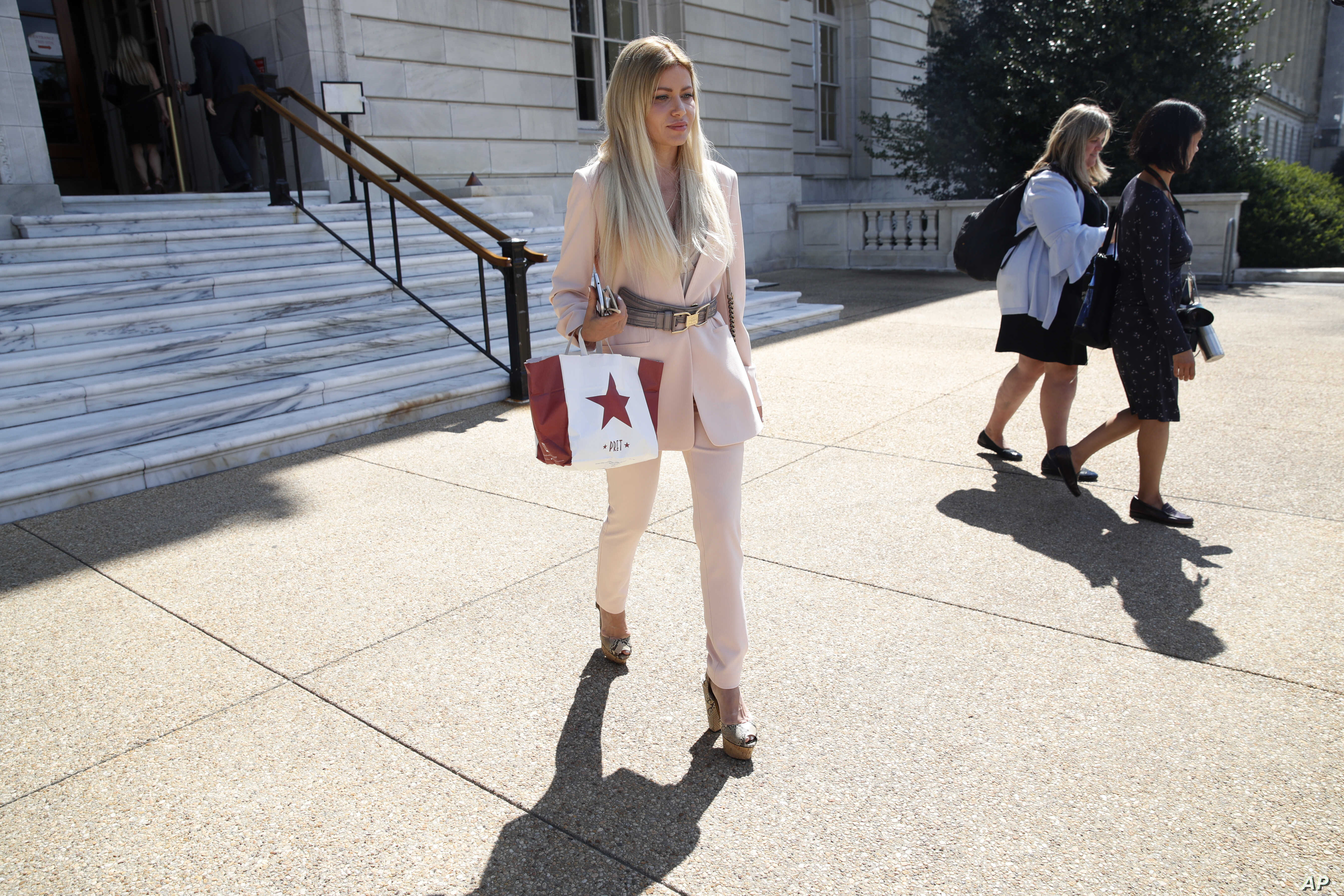 Simona Mangiante Papadopoulos, wife of former Donald Trump campaign adviser George Papadopoulos, leaves the Cannon House Office Building after attending a closed-door meeting with Democrats on the House intelligence committee, July 18, 2018, on Capit...