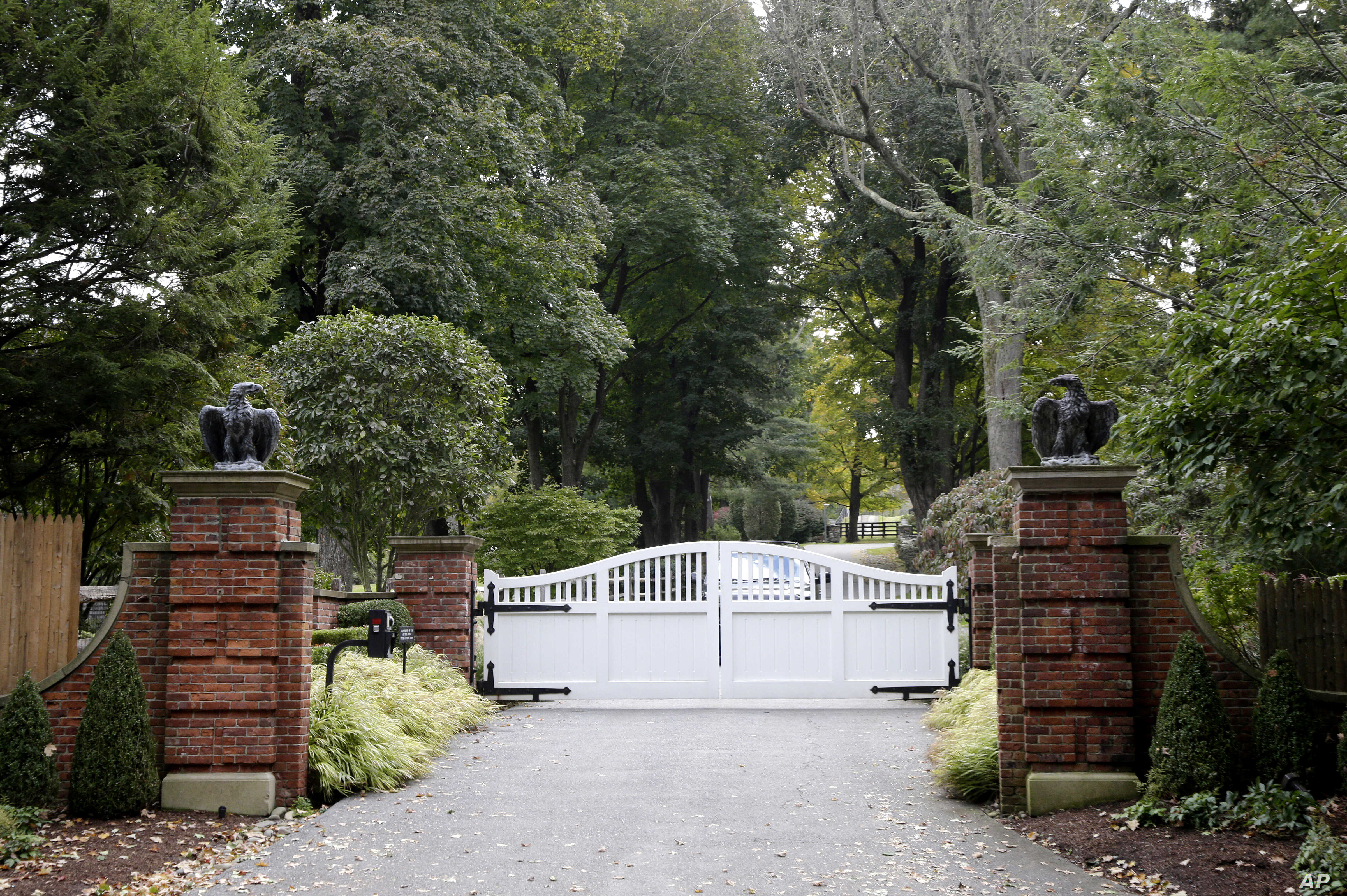 The gate is closed at the entrance to a house owned by philanthropist George Soros in Katonah, N.Y., a suburb of New York City,  Oct. 23, 2018.