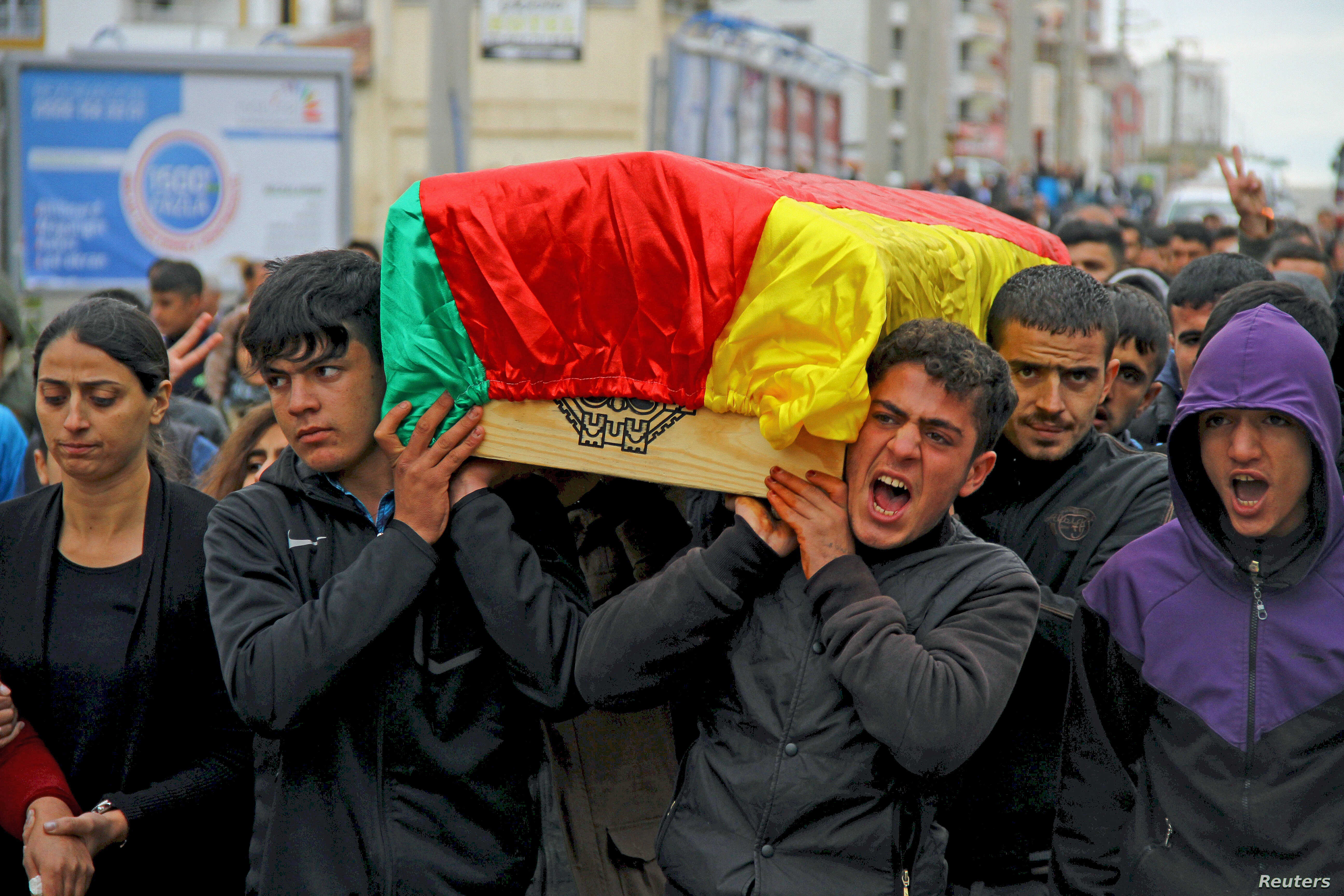 Mourners carry coffin of Yakup Sinbag, a civilian who was killed during the clashes between Turkish security forces and Kurdish militants, in Silvan in the southeastern Diyarbakir province, Turkey, Nov. 10, 2015.