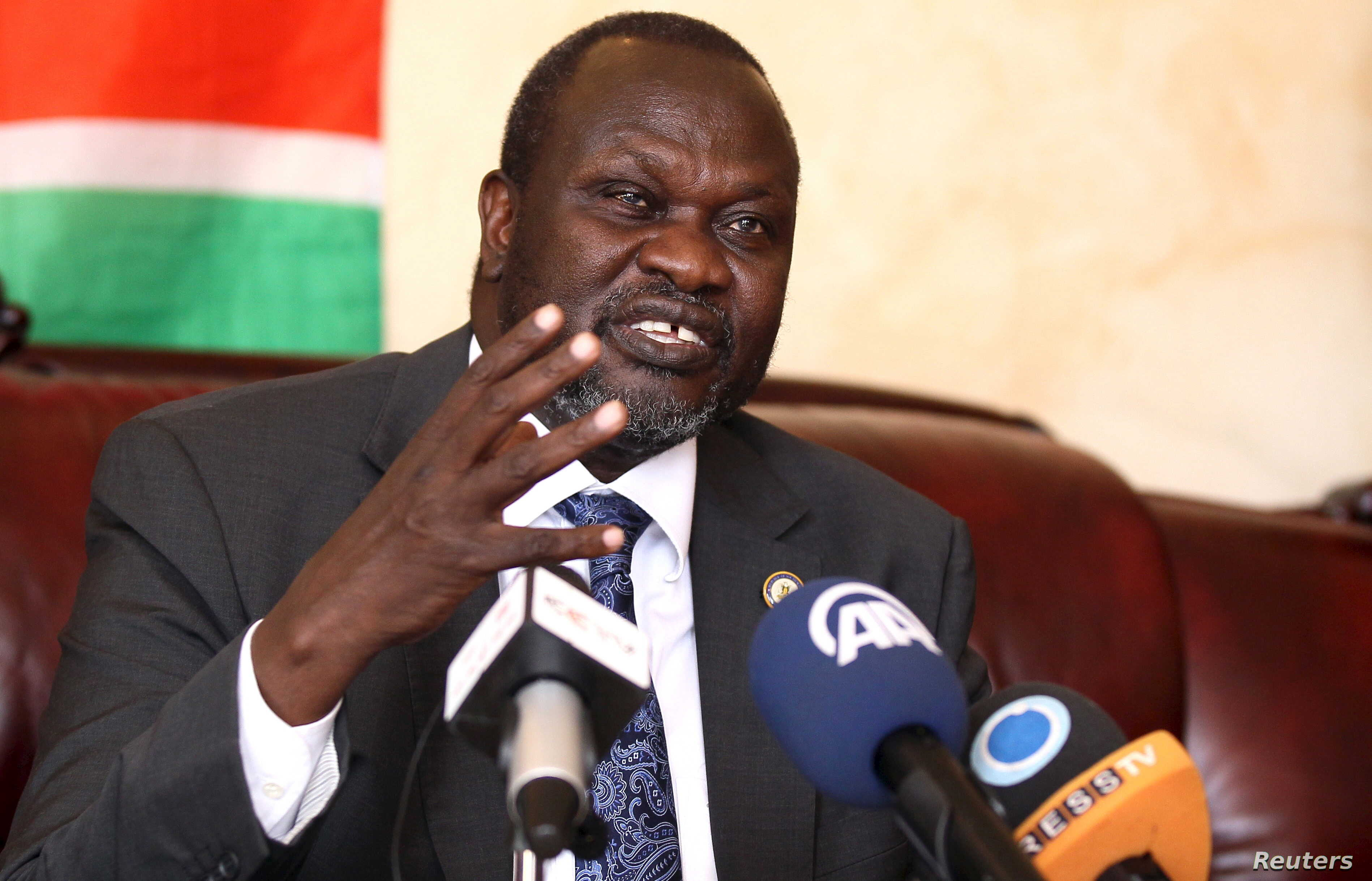 South Sudan's rebel leader Riek Machar addresses a news conference in Ethiopia's capital Addis Ababa, Oct. 18, 2015.