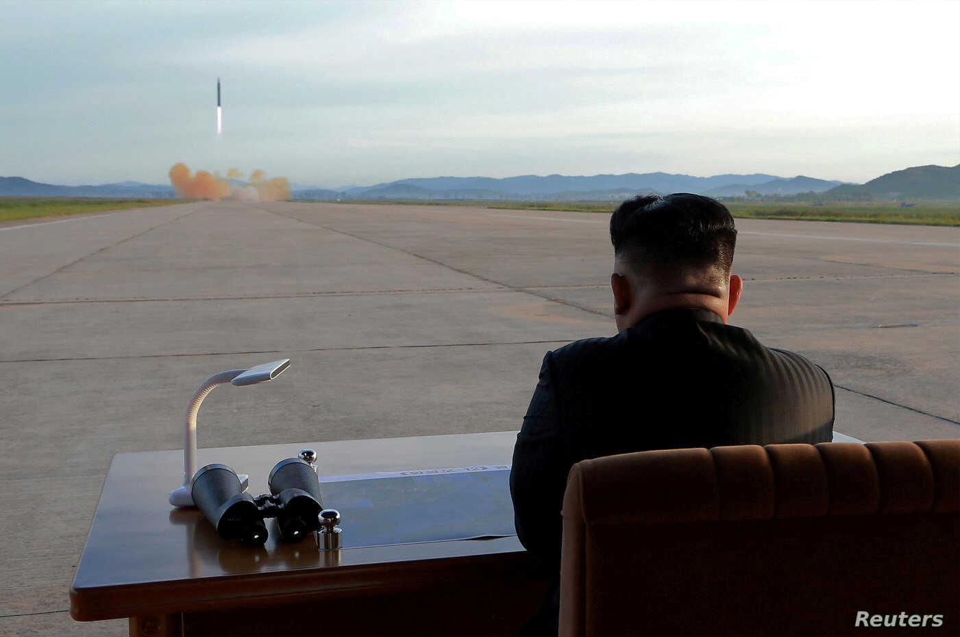 FILE - North Korean leader Kim Jong Un watches the launch of a Hwasong-12 missile in this undated photo released by North Korea's Korean Central News Agency (KCNA).