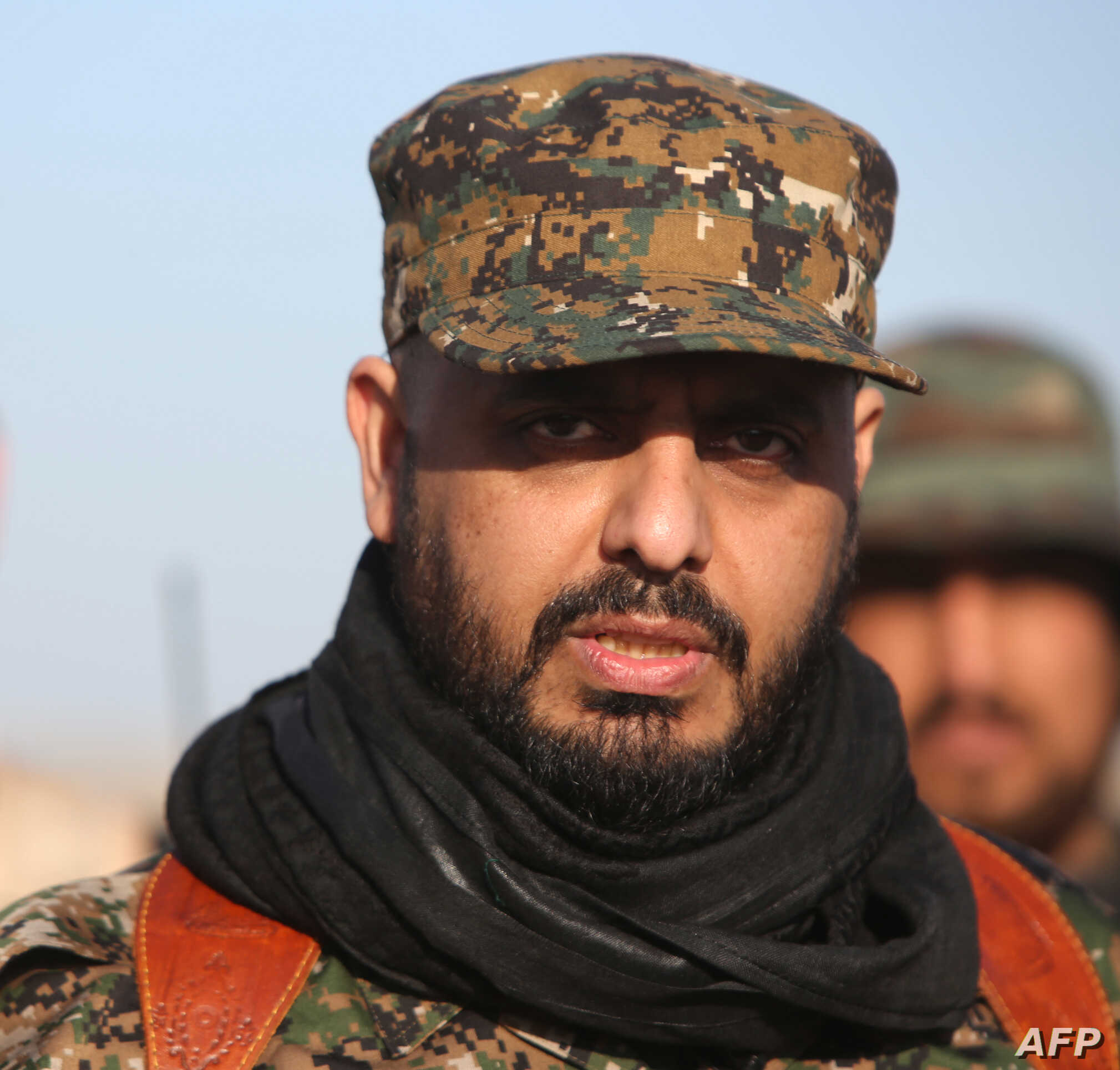 Qais al-Khazali, leader of the Shiite militia Asaib Ahl al-Haq (The League of the Righteous), looks on as he stands in the area of Albu Ajil, east of the northern city of Tikrit on March 7, 2015, during a military operation to retake the Tikrit area....