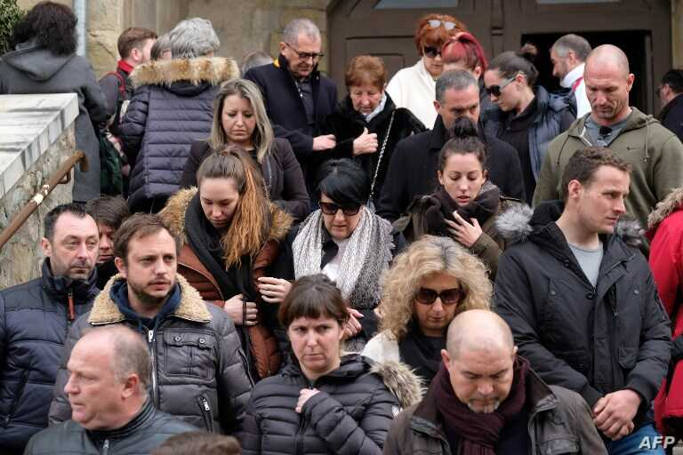 Mourners leave the service of remembrance at the Saint Etienne Church in Trebes in southwest France, on March 25, 2018, two days after Radouane Lakdim carried out an attack in which four people were killed.