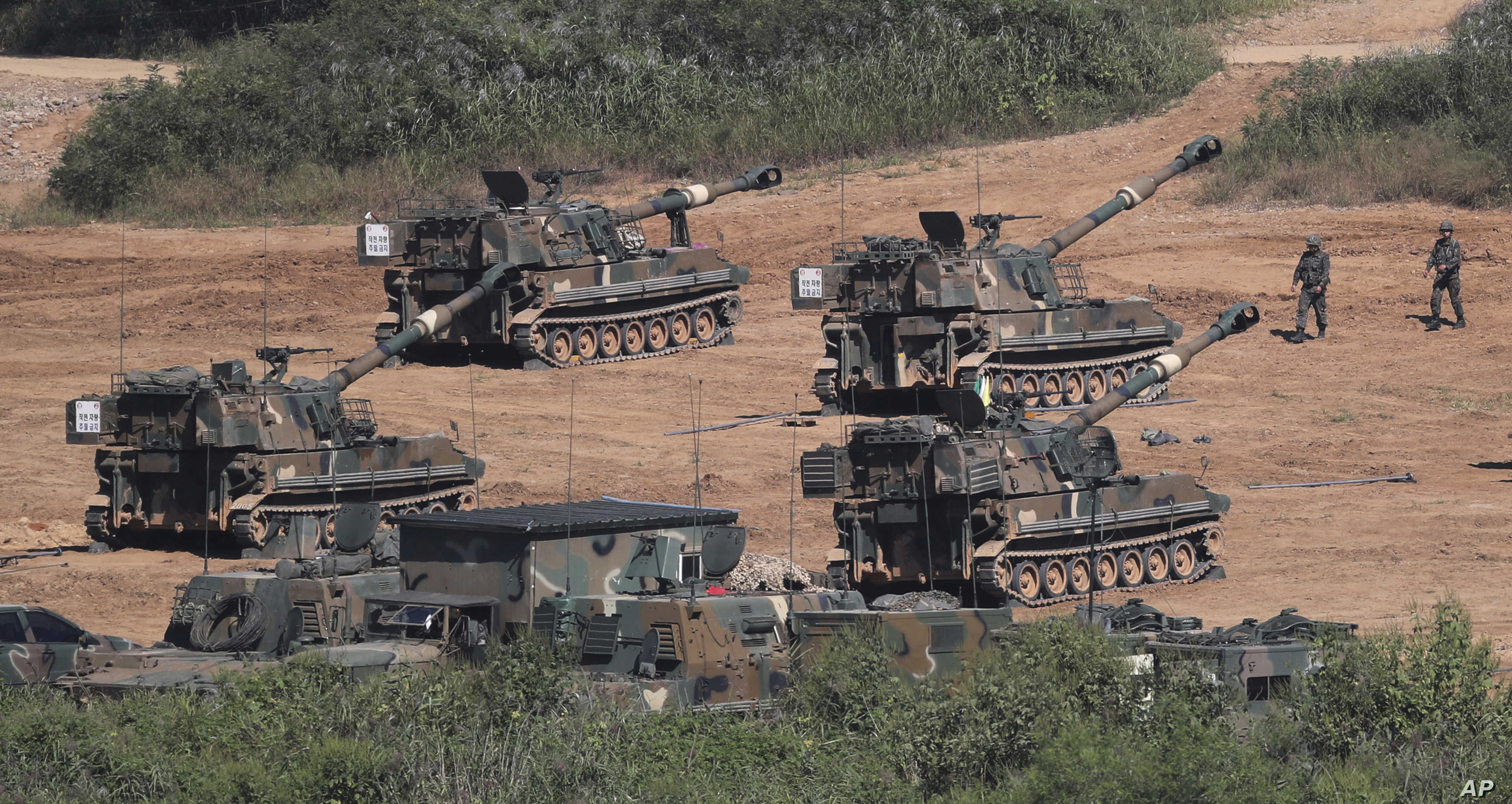 South Korean army K-55 self-propelled howitzers conduct a military exercise in Paju, South Korea, near the border with North Korea, Sept. 15, 2017.