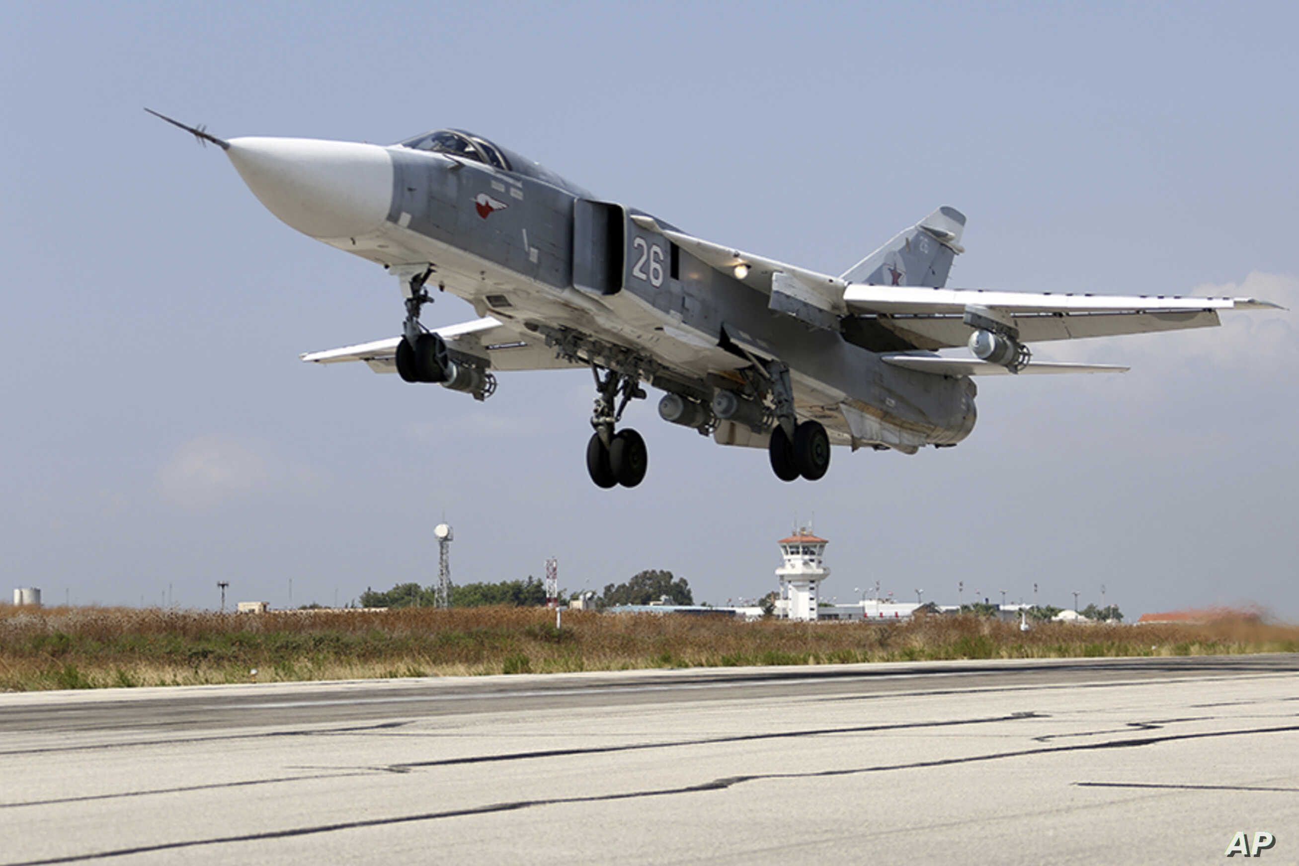 In this photo taken from Russian Defense Ministry official website on Oct. 6, 2015, a Russian  SU-24M jet fighter takes off from an airbase Hmeimim in Syria.