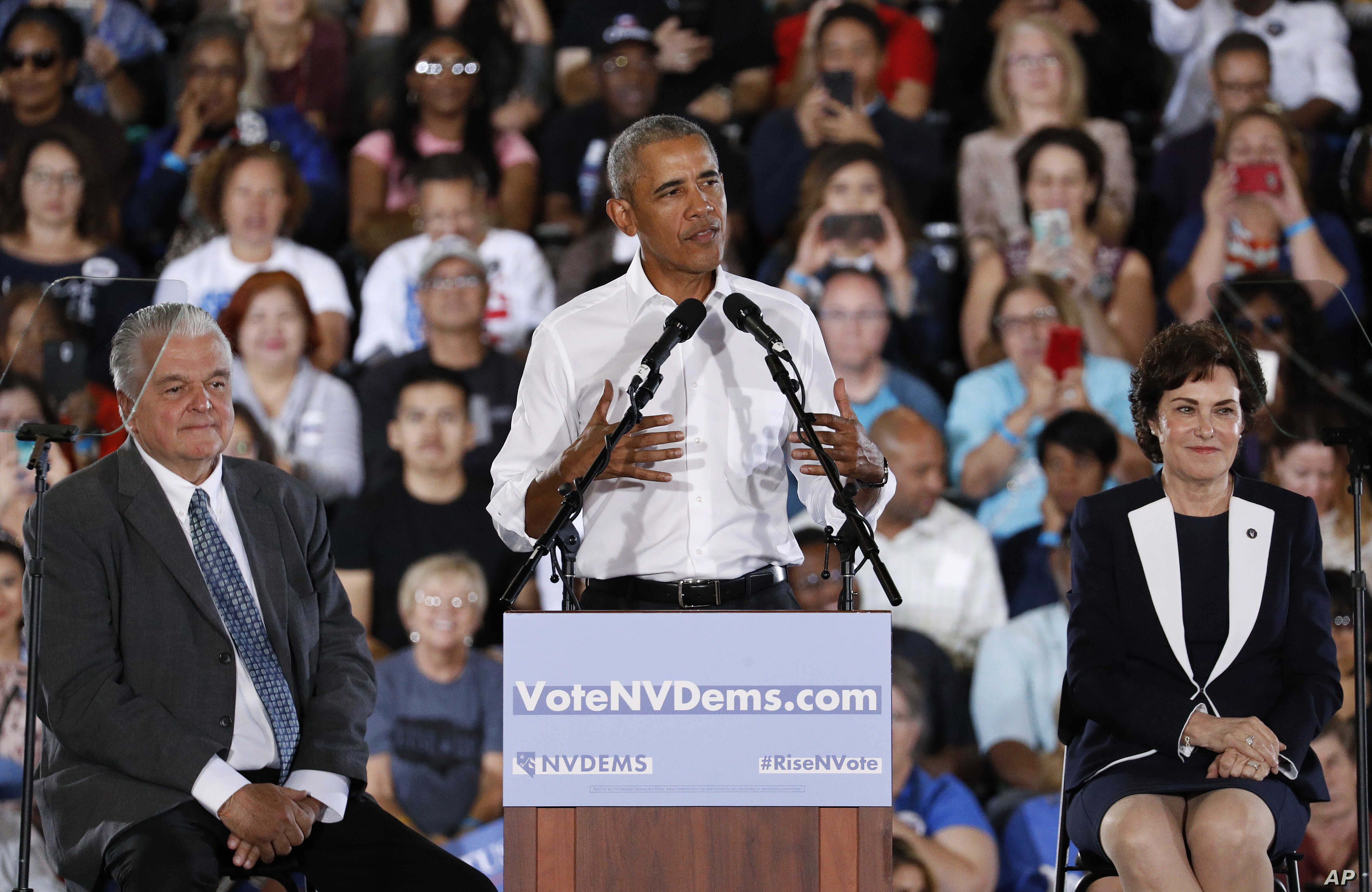 Former President Barack Obama speaks at a rally in support of candidate for Senate Rep. Jacky Rosen, D-Nev., right, and Clark County Commission Chair and Democratic gubernatorial candidate Steve Sisolak, left, Oct. 22, 2018, in Las Vegas.