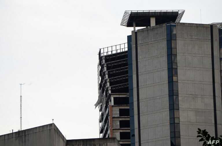 An unfinished abandoned skyscraper Torre de David is seen leaning in Caracas, Aug. 21, 2018, following a 7.3-magnitude earthquake that struck in the Venezuelan northeastern state of Sucre.