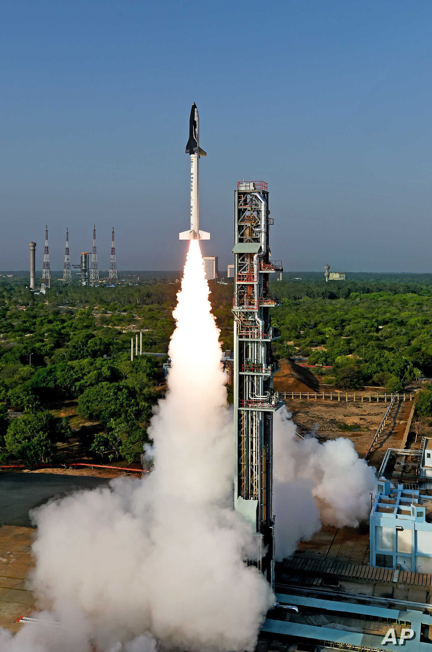 India's first indigenously made and reusable space launch vehicle is seen lifted off from the launch pad at Satish Dhawan Space Center in Sriharikota, in the southern Indian state of Andhra Pradesh, May 23, 2016.