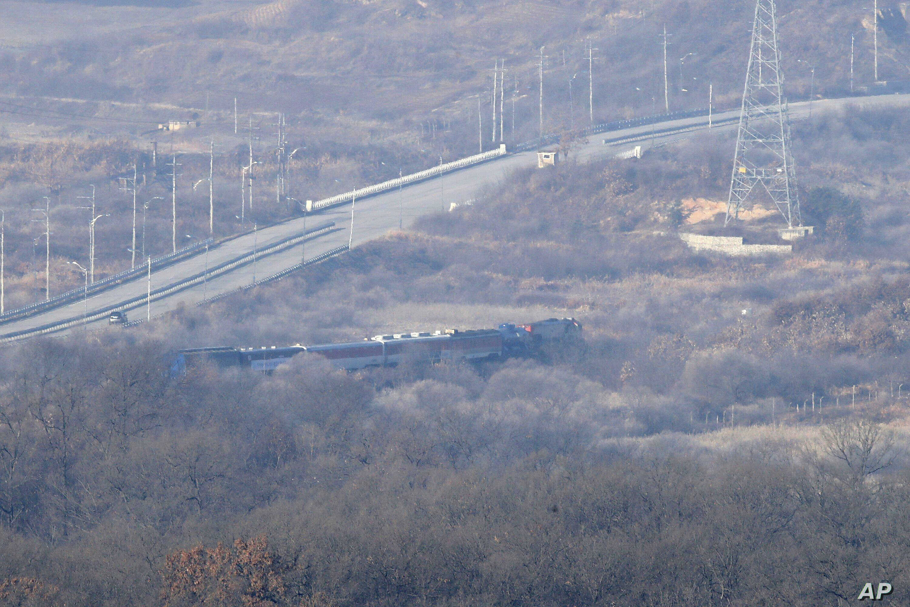 A South Korean train transporting dozens of South Korean officials runs on the rails which leads to North Korea, inside the demilitarized zone separating the two Koreas in Paju, South Korea, Nov. 30, 2018.
