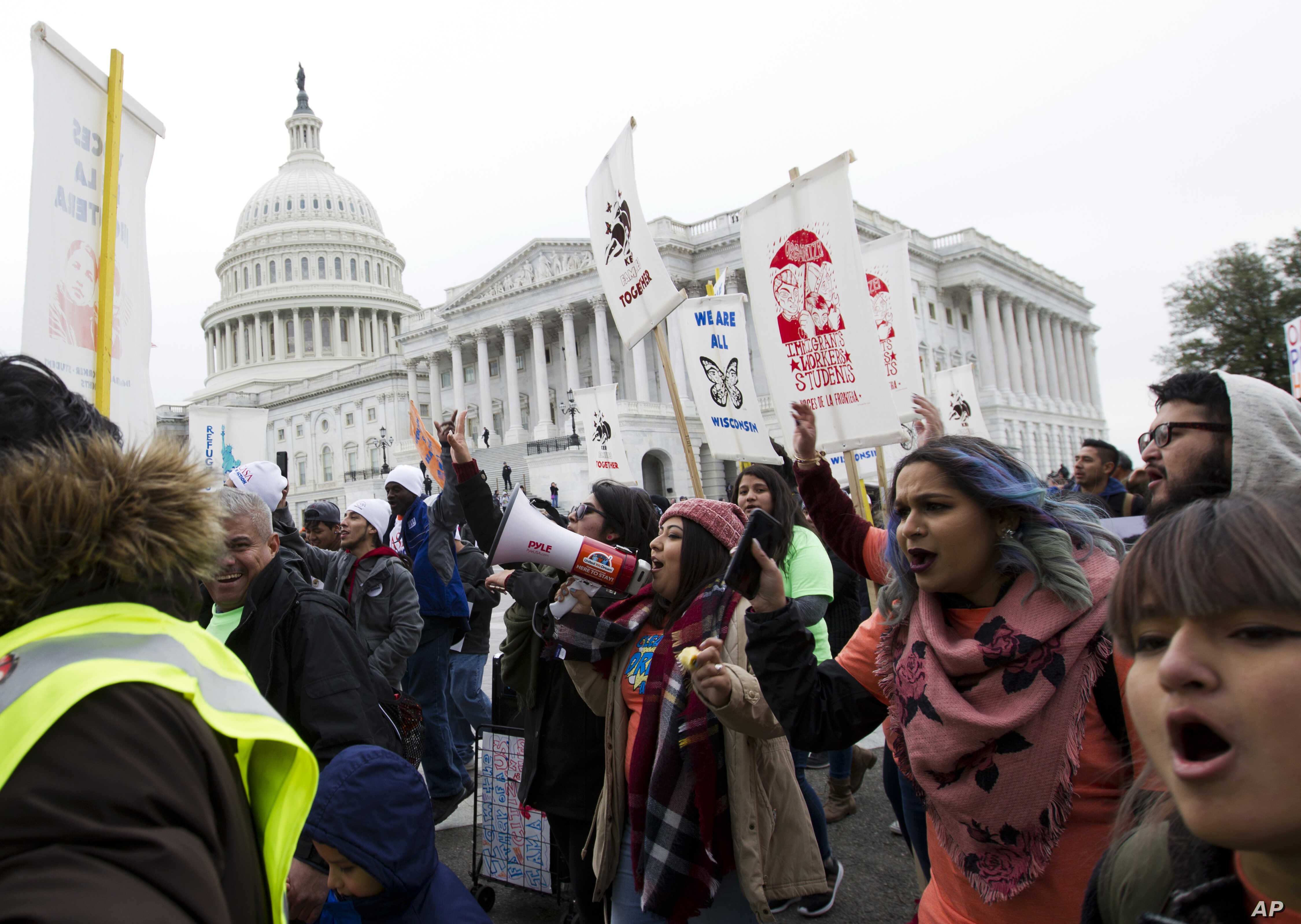 FILE - Demonstrators march during an immigration rally in support of the Deferred Action for Childhood Arrivals (DACA), on Capitol Hill in Washington, Dec. 6, 2017.
