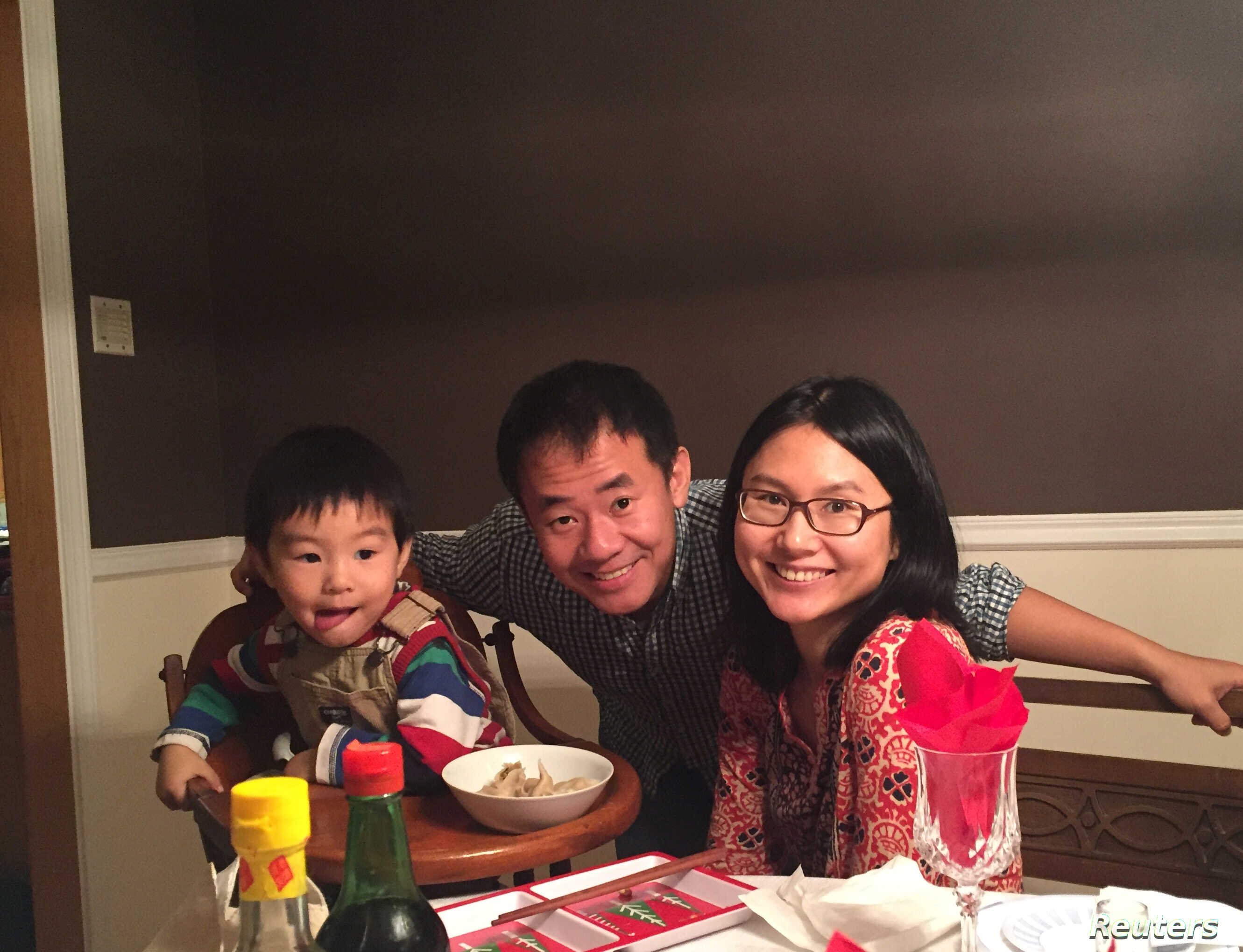 Xiyue Wang, a naturalized American citizen from China, arrested in Iran last August while researching Persian history for his doctoral thesis at Princeton University, is shown with his wife and son in this family photo released in Princeton, New Jers
