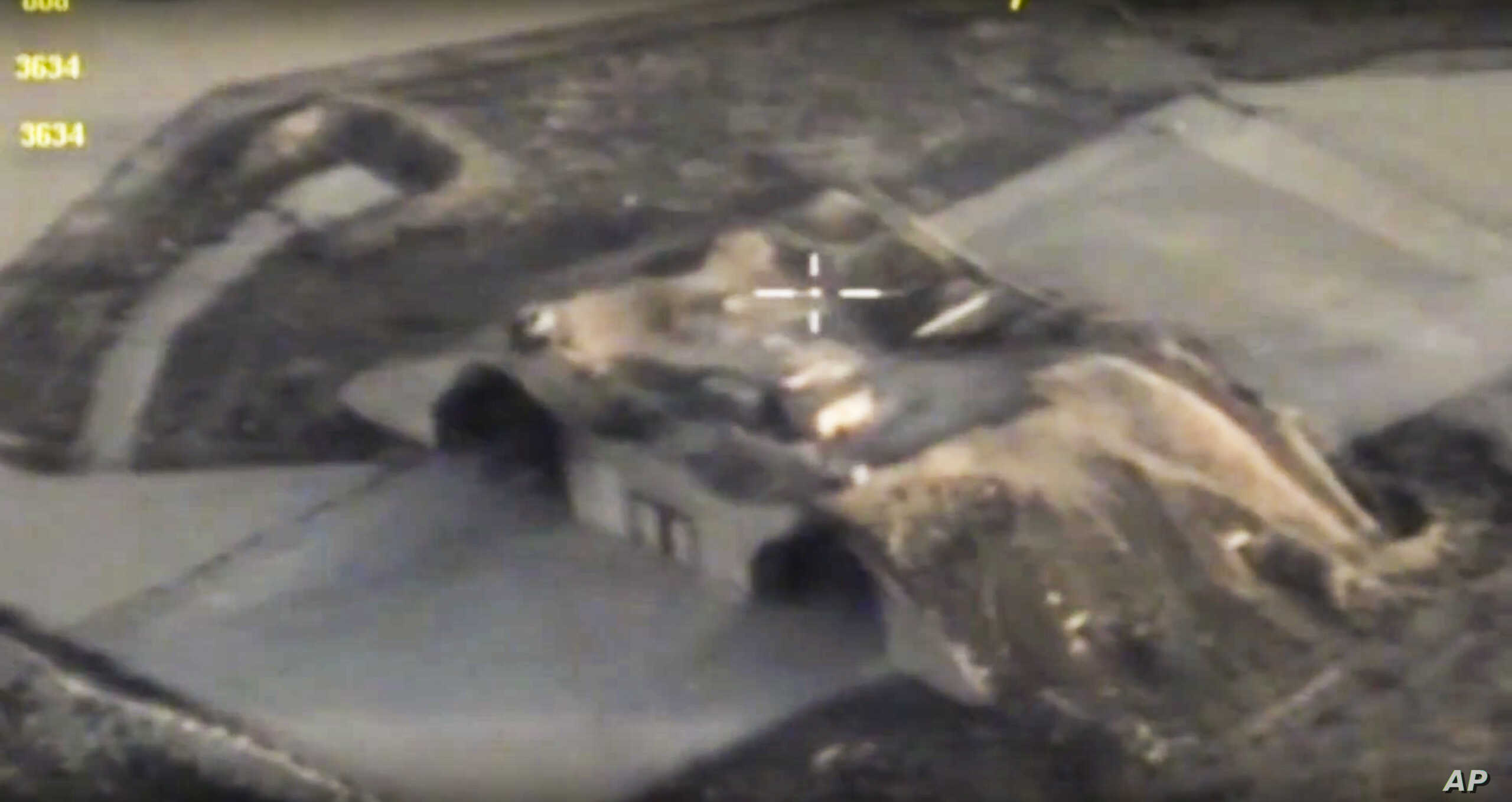 In this photo made from the footage taken from Russian Defense Ministry official website April 7, 2017, an aerial view shows shelters for aircraft at a Syrian air base after it was hit by U.S. strike in Syria.