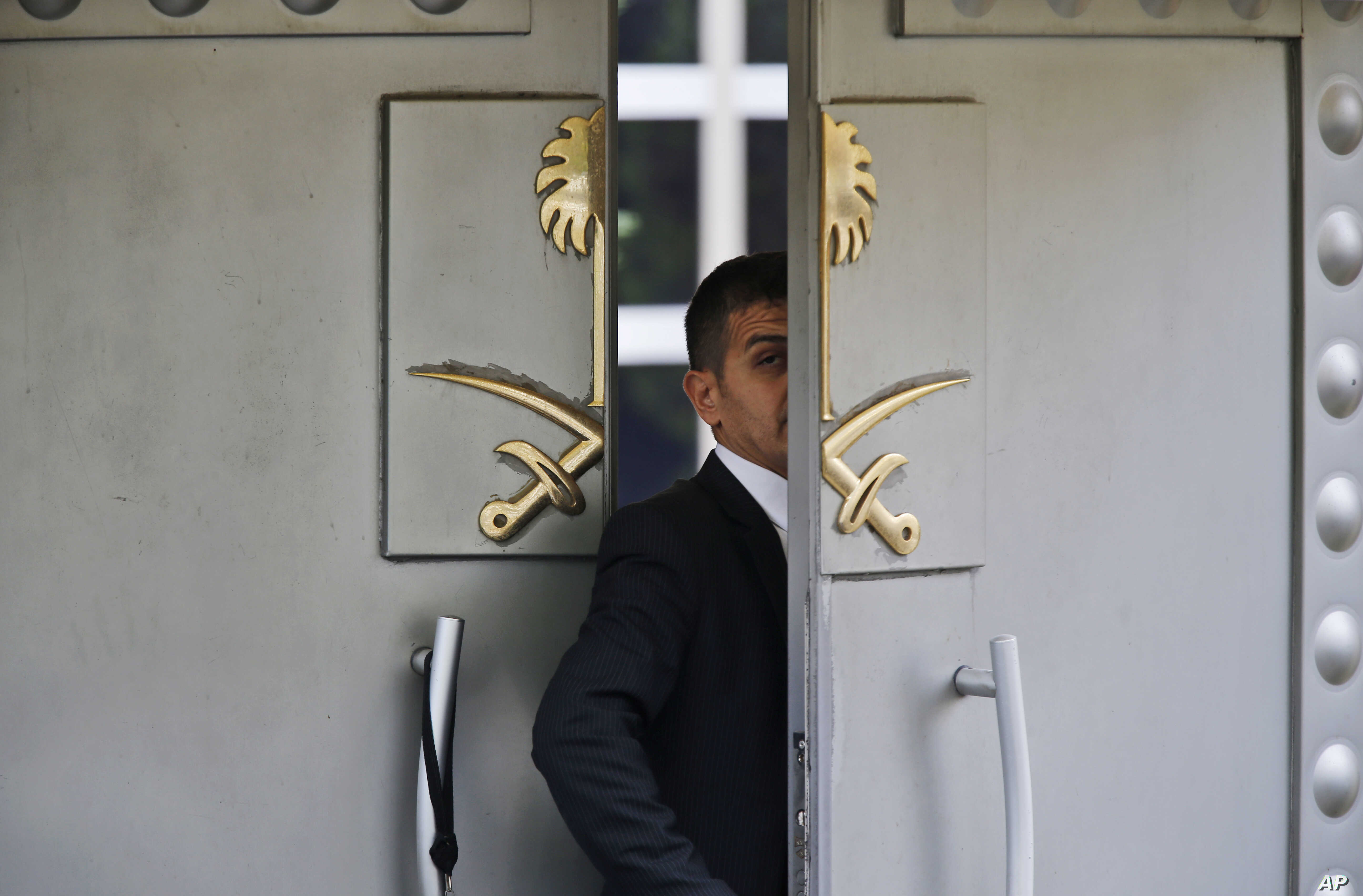 In this Tuesday, Oct. 9, 2018 file photo, a security guard walks in the Saudi Arabia consulate in Istanbul, Turkey. The Trump administration's ongoing courtship of Saudi Arabia is on pause.