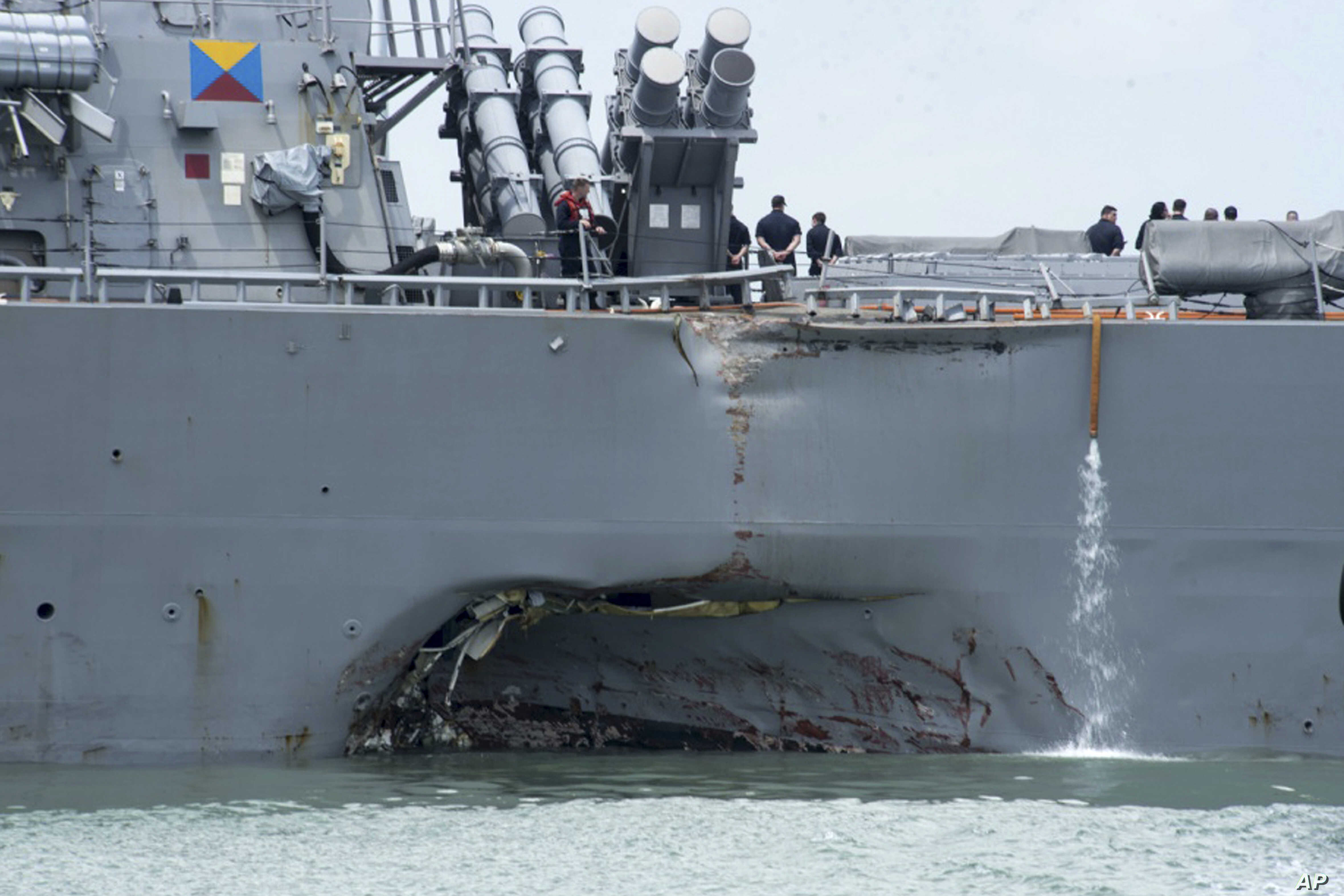 FILE - damage is visible as the guided-missile destroyer USS John S. McCain steers towards Changi naval base in Singapore following a collision with the merchant vessel Alnic MC.