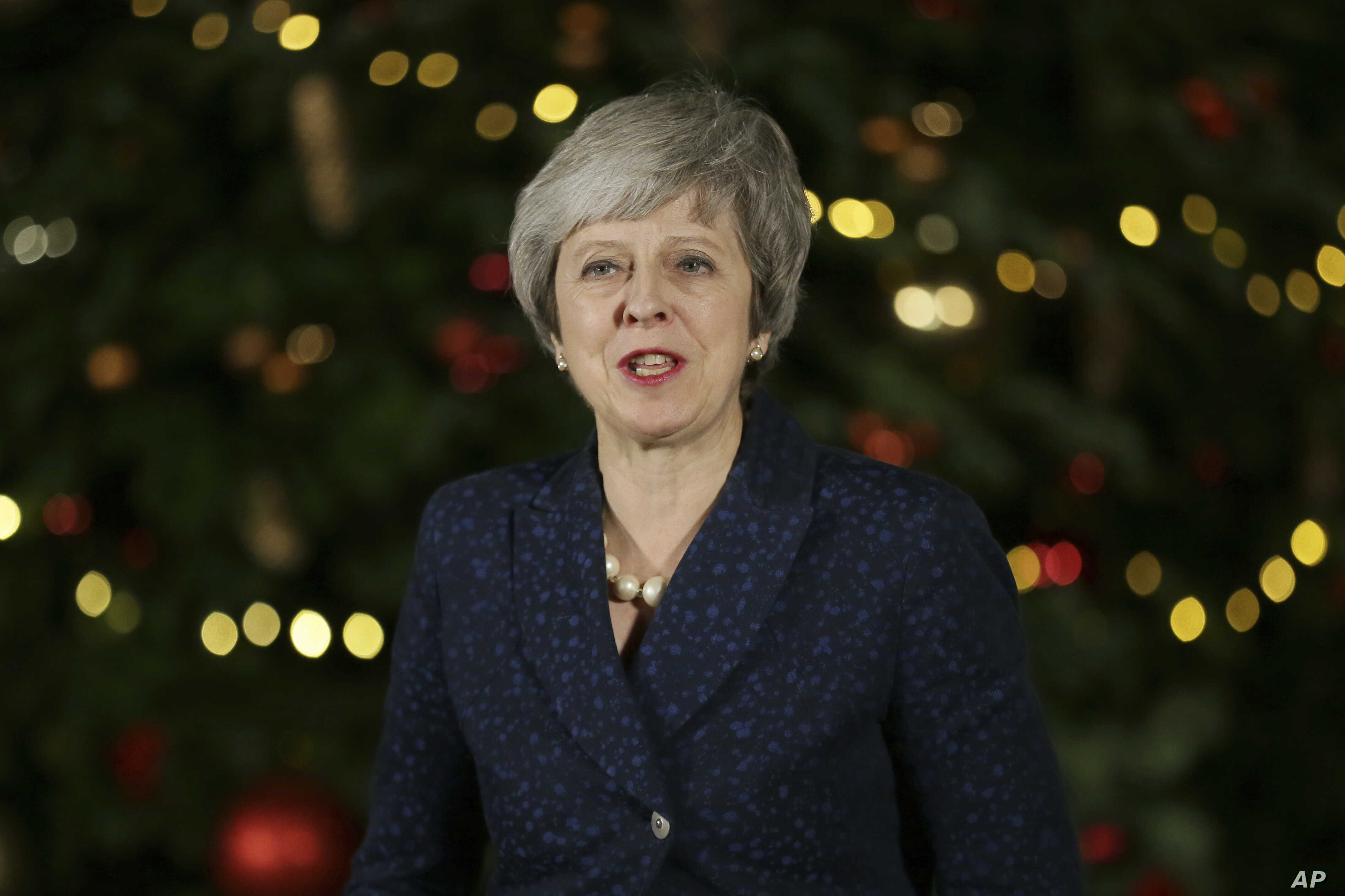 British Prime Minister Theresa May makes a statement outside 10 Downing Street, in London, Dec. 12, 2018. British Prime Minister Theresa May survived a brush with political mortality Wednesday, winning a no-confidence vote of her Conservative lawmake...