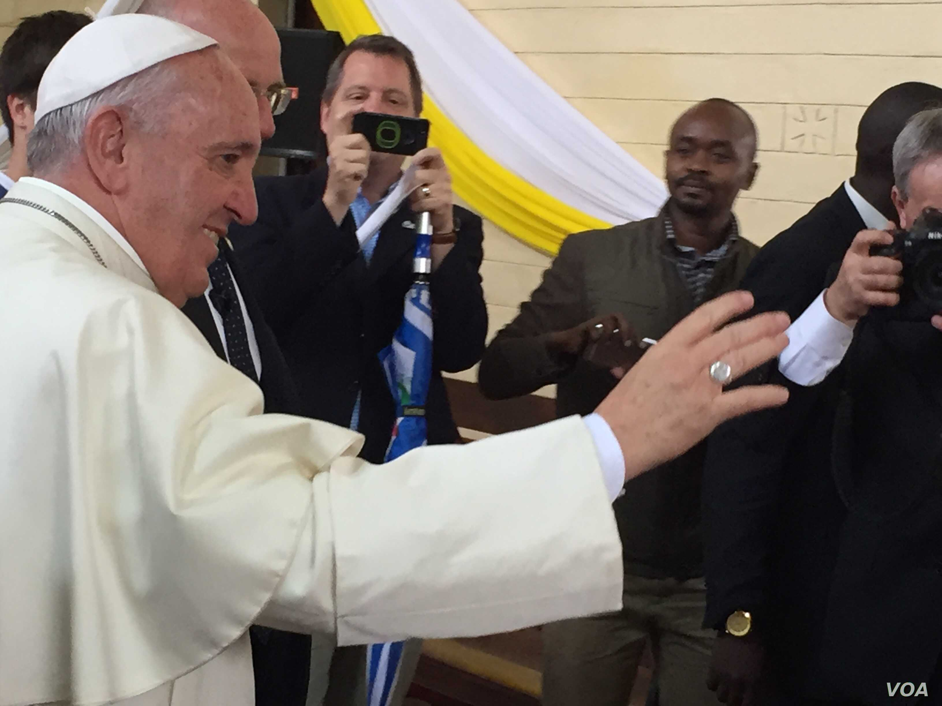 The Pope exiting the church after the event in Nairobi's Kangemi slum, Nov. 27, 2015. (J. Craig/VOA)