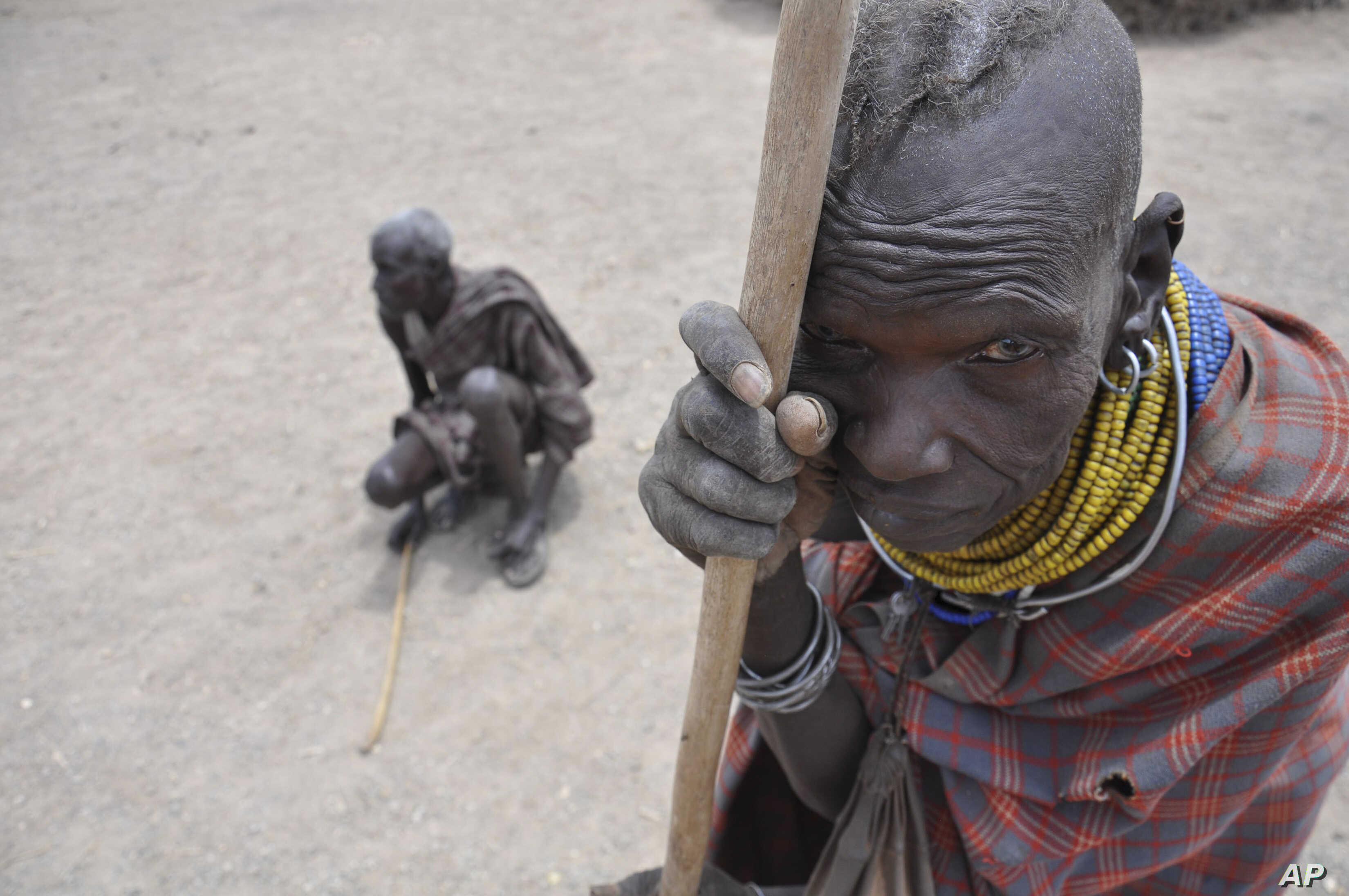 FILE - In this Aug. 30, 2011 photo, an elderly woman and her husband wait during a famine for the distribution of food from Oxfam, in central Turkana district, Kenya.