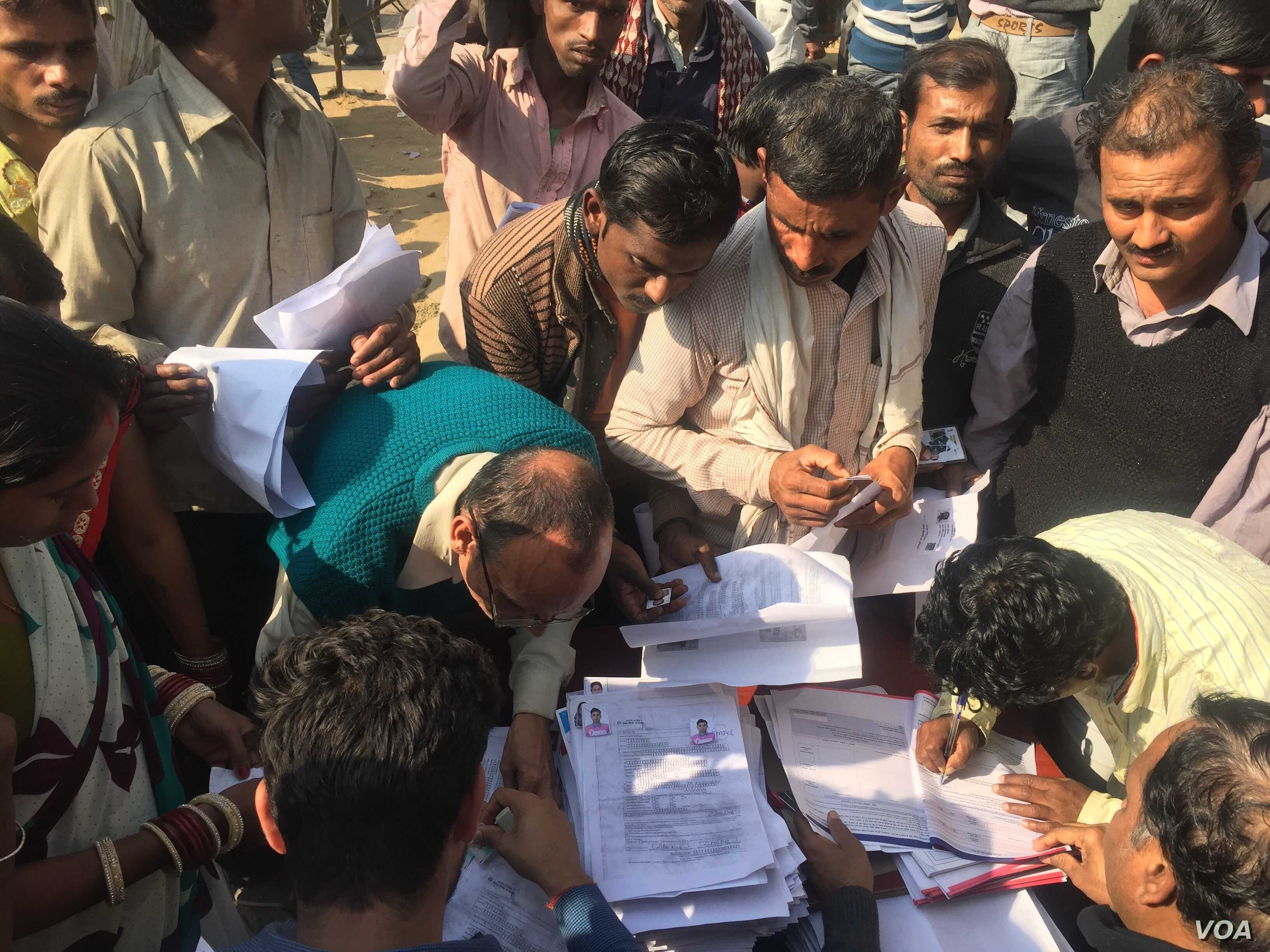 Bank official C.R. Khobba says they expect to open 150 to 200 accounts in a single day at a temporary camp for workers.