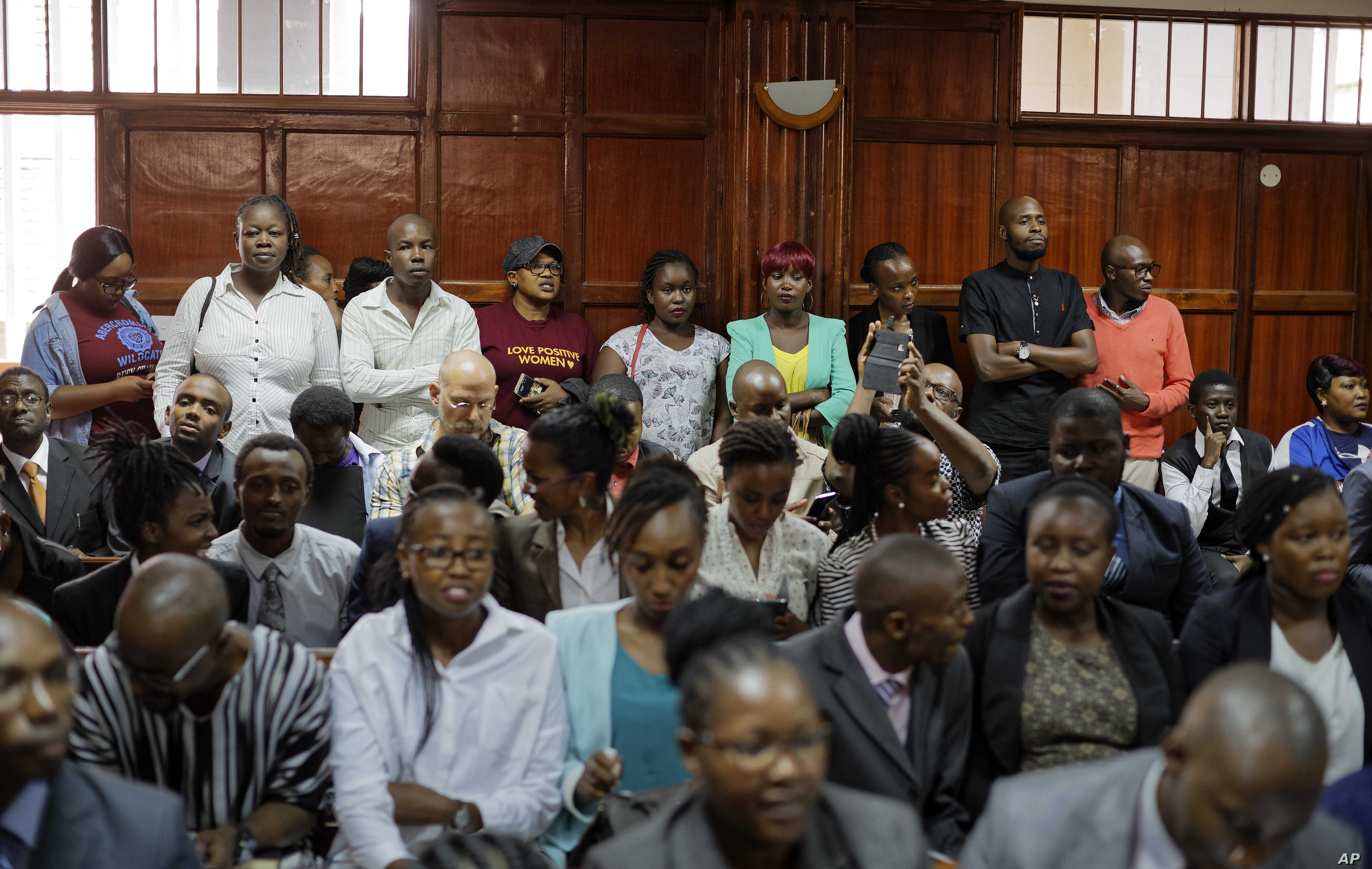 Members of the public fill the courtroom as the High Court in Kenya begins hearing arguments in a case challenging parts of the penal code seen as targeting the lesbian, gay, bisexual and transgender communities, at the High Court in Nairobi, Kenya, ...