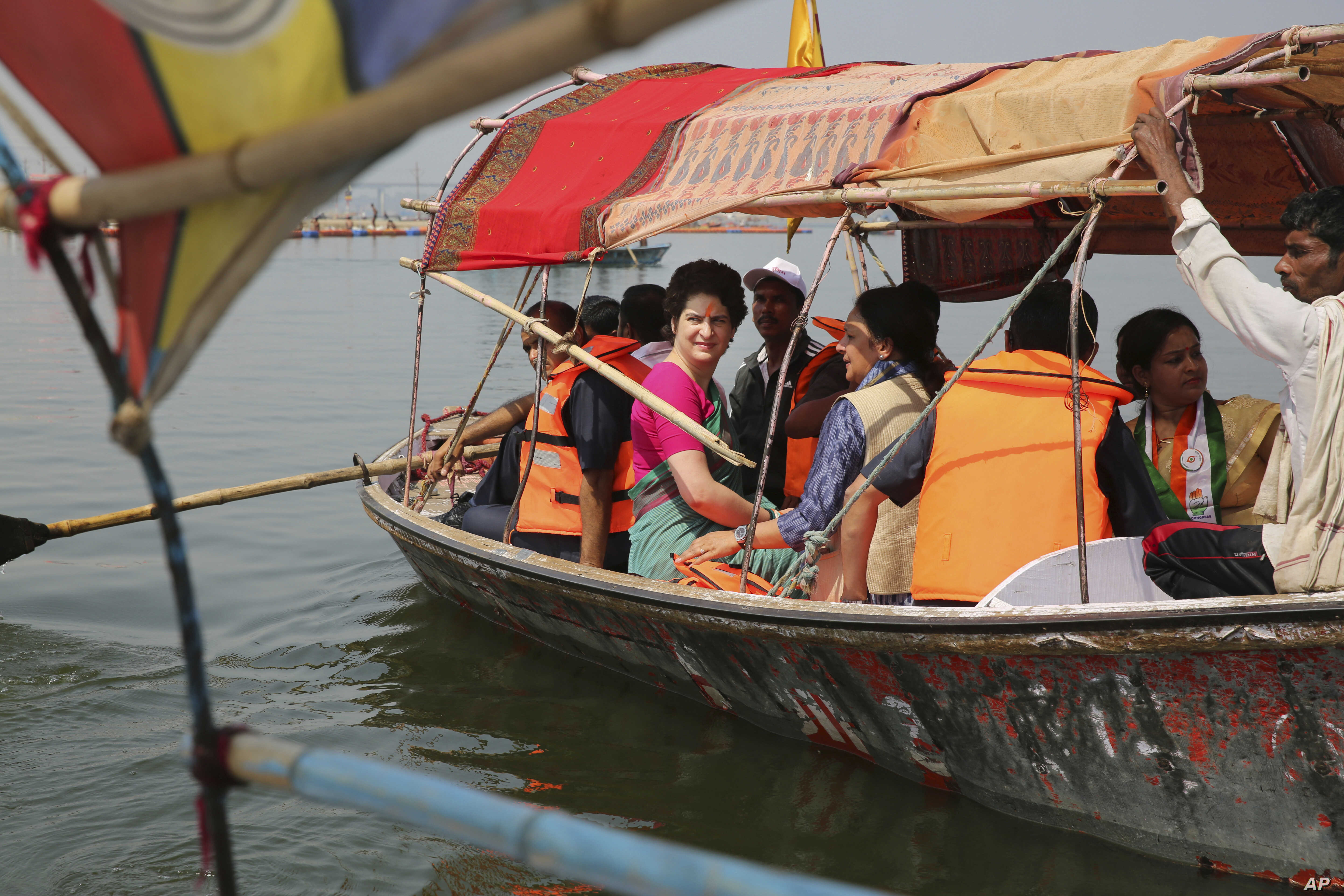 Congress party General Secretary and eastern Uttar Pradesh state in-charge Priyanka Gandhi Vadra, center, takes a boat ride to the Sangam, the confluence of sacred rivers the Yamuna, the Ganges and the mythical Saraswati, in Prayagraj, India, March 1...