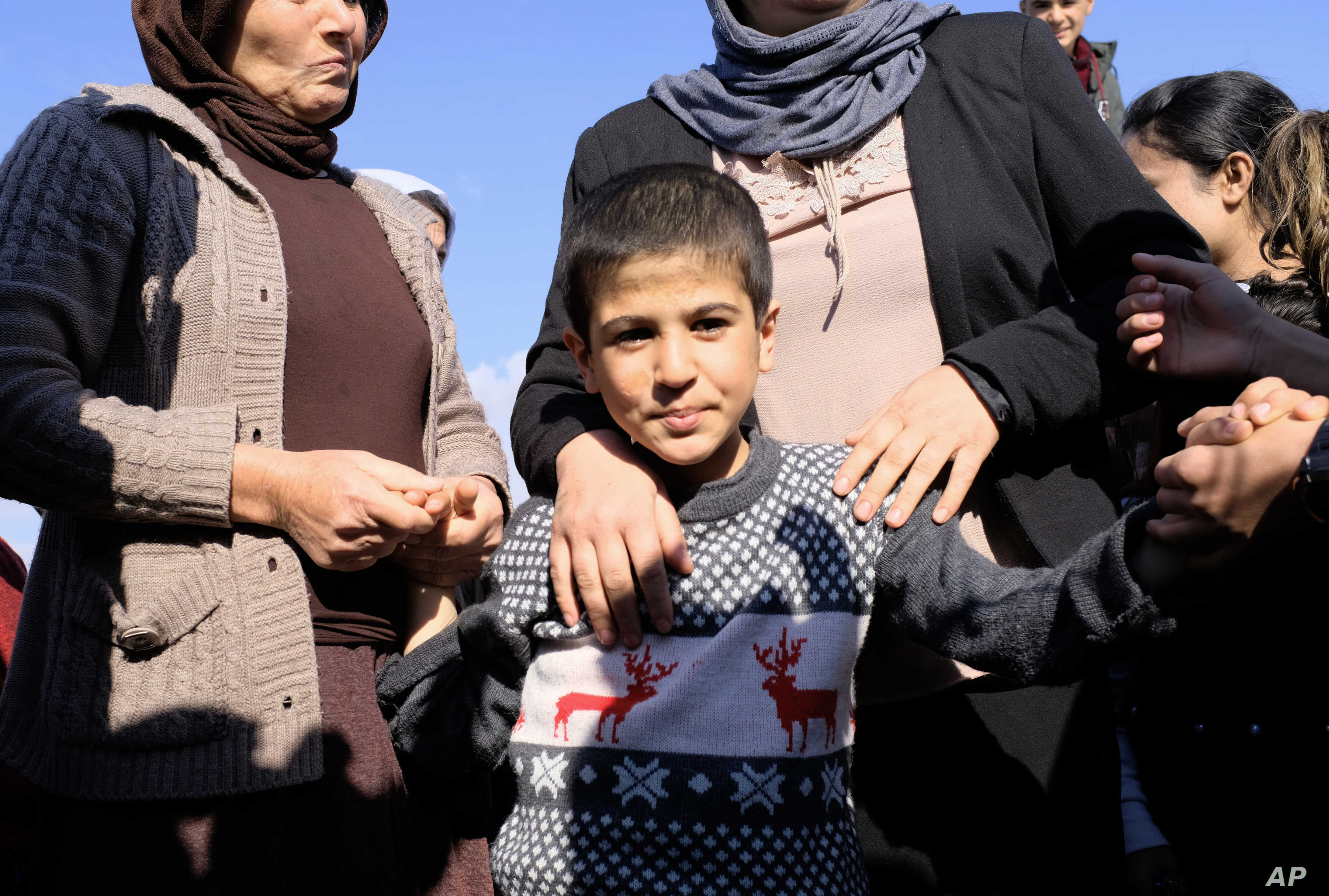 Dilbar Ali Ravu, 10, is reunited with his family in Iraq after five years of captivity with the Islamic State group, March 2, 2019.