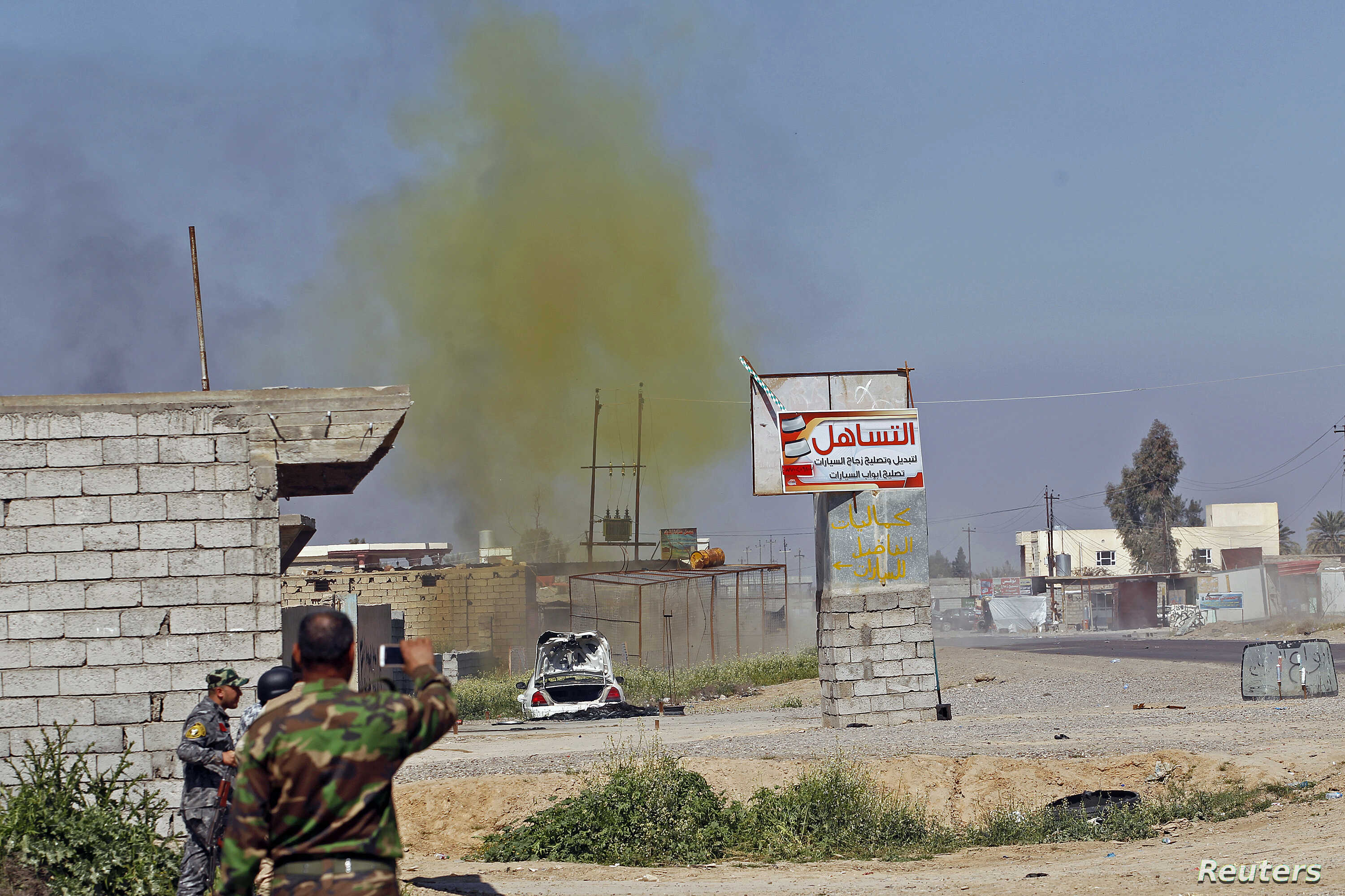 File - A chlorine-tinged cloud of smoke rises into the air from an alleged Islamic State bomb that was detonated by Iraqi army and Shi'ite fighters, in the town of al-Alam in Salahuddin province, March 10, 2015.