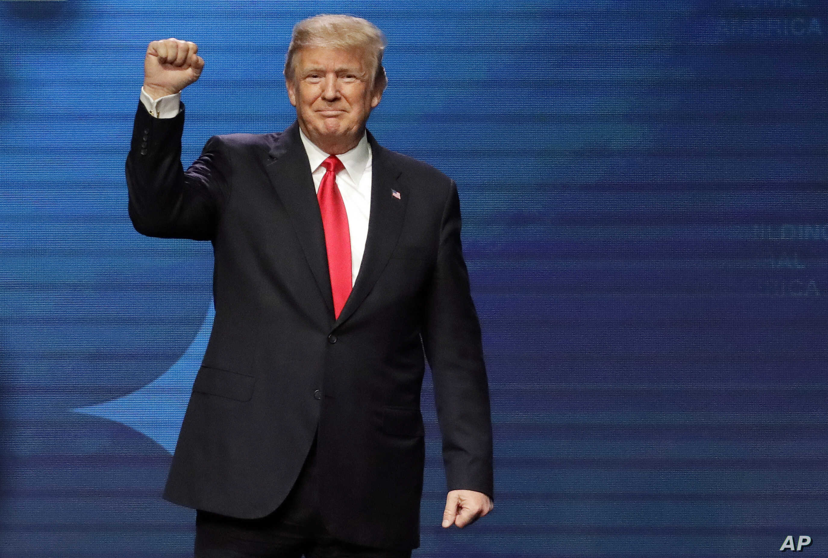 President Donald Trump acknowledges applause after speaking at the American Farm Bureau Federation annual convention Monday, Jan. 8, 2018, in Nashville, Tenn.