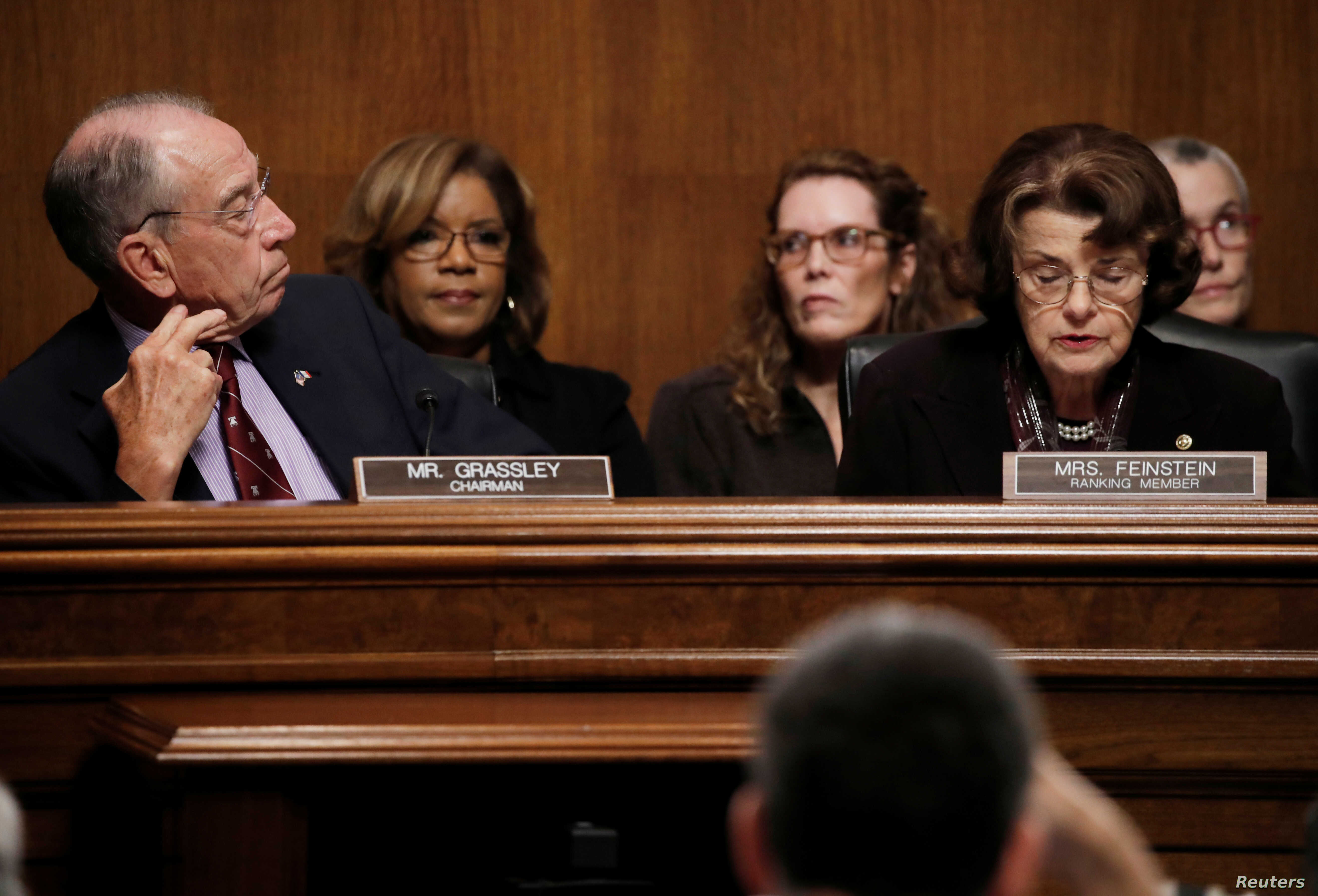 Senate Judiciary Committee Chairman Chuck Grassley (R-IA) looks over at ranking member Sen. Dianne Feinstein (D-CA) as members of the Senate Judiciary Committee meet to vote on the nomination of judge Brett Kavanaugh to be a U.S. Supreme Court associ...