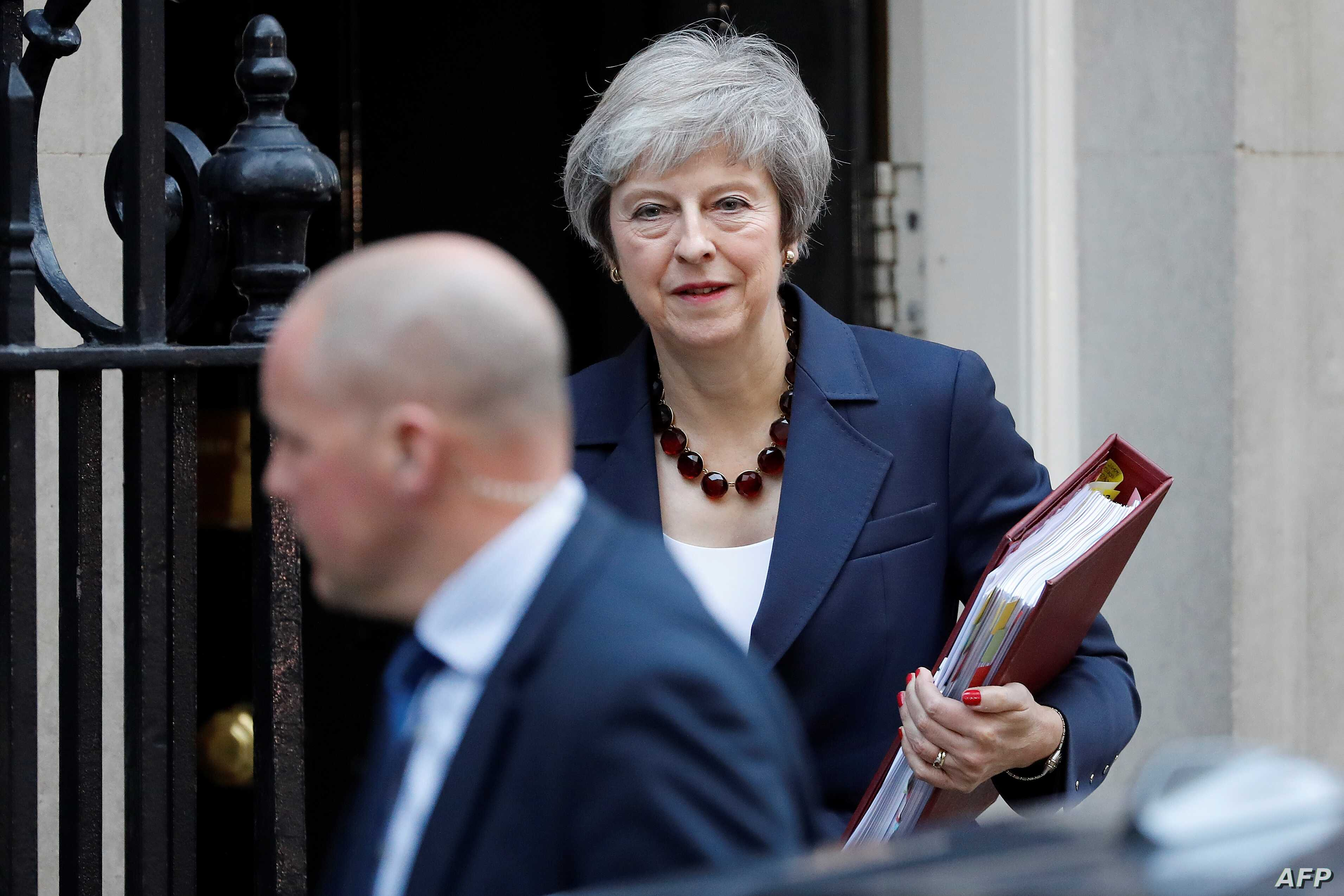 Britain's Prime Minister Theresa May leaves 10 Downing Street in London on November 14, 2018, to attend the weekly Prime Minister's Questions at the Houses of Parliament.