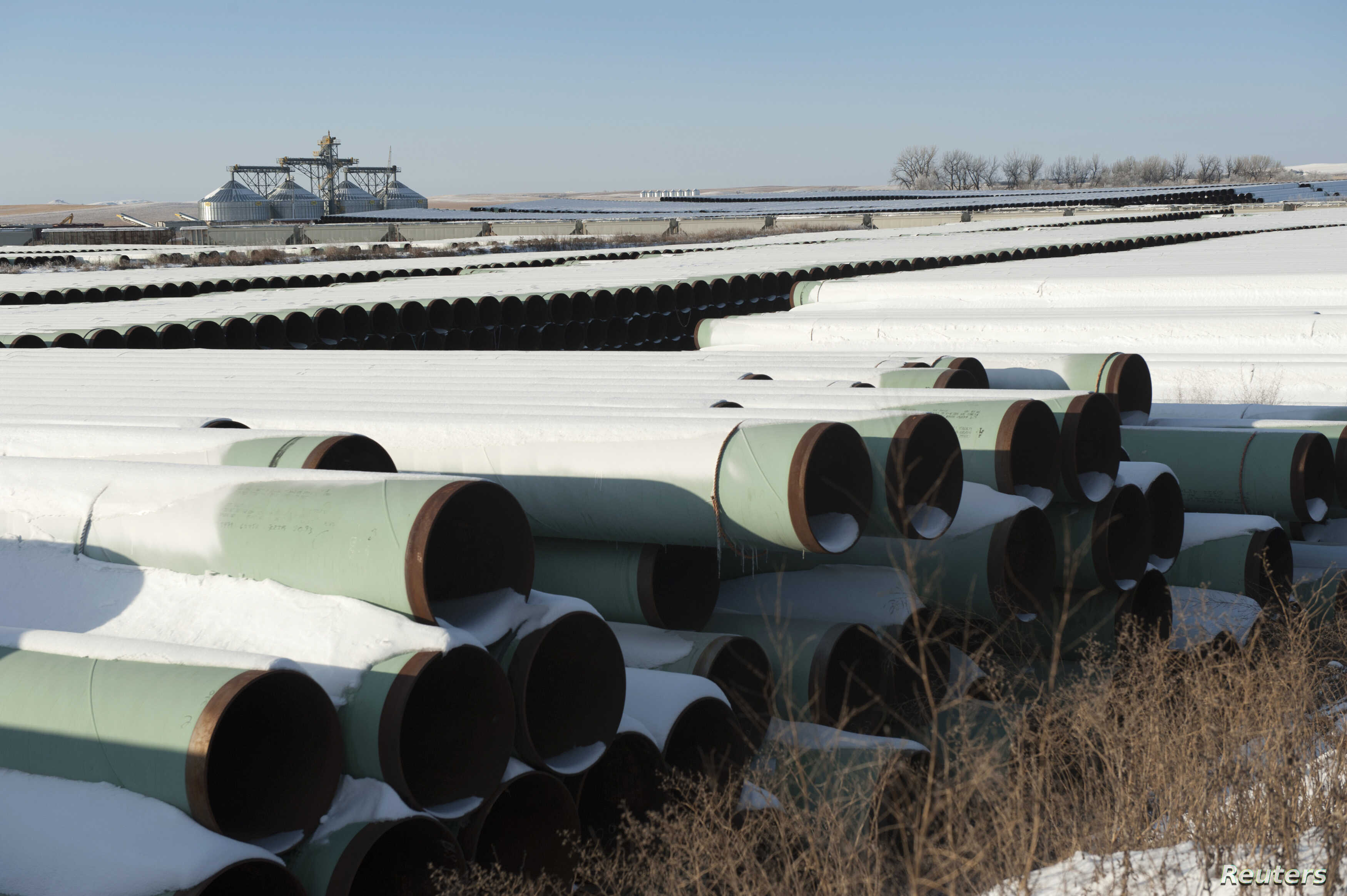 FILE - A depot used to store pipes for TransCanada Corp.'s planned Keystone XL oil pipeline is seen in Gascoyne, North Dakota, Nov. 14, 2014.