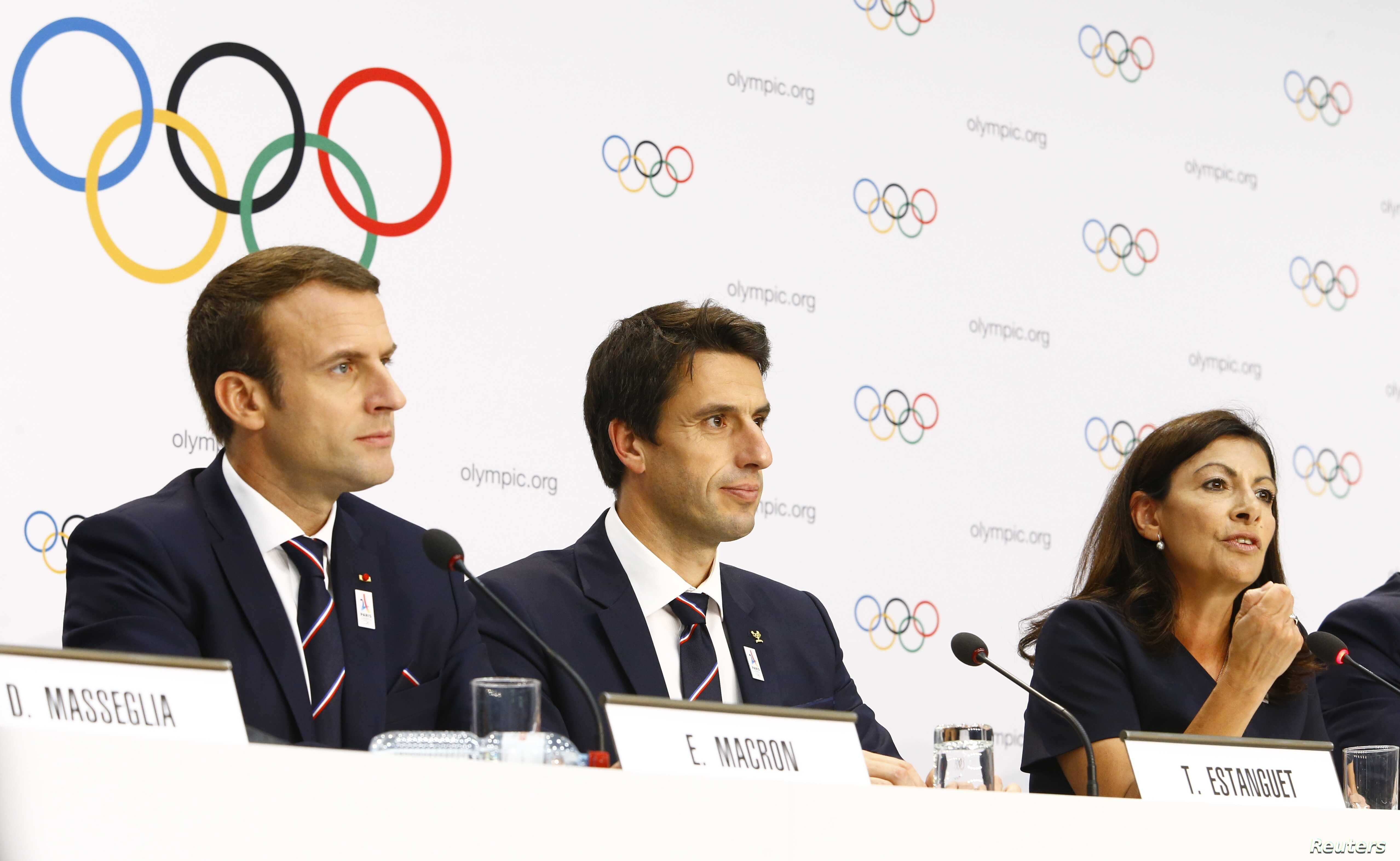French President Emmanuel Macron, Paris mayor Anne Hidalgo and French slalom canoeist Tony Estanguet attend the briefing of 2024 Olympic Games candidate cities Paris and Los Angeles ahead of final election of 2024 Olympic host city, in Lausanne, Swit...