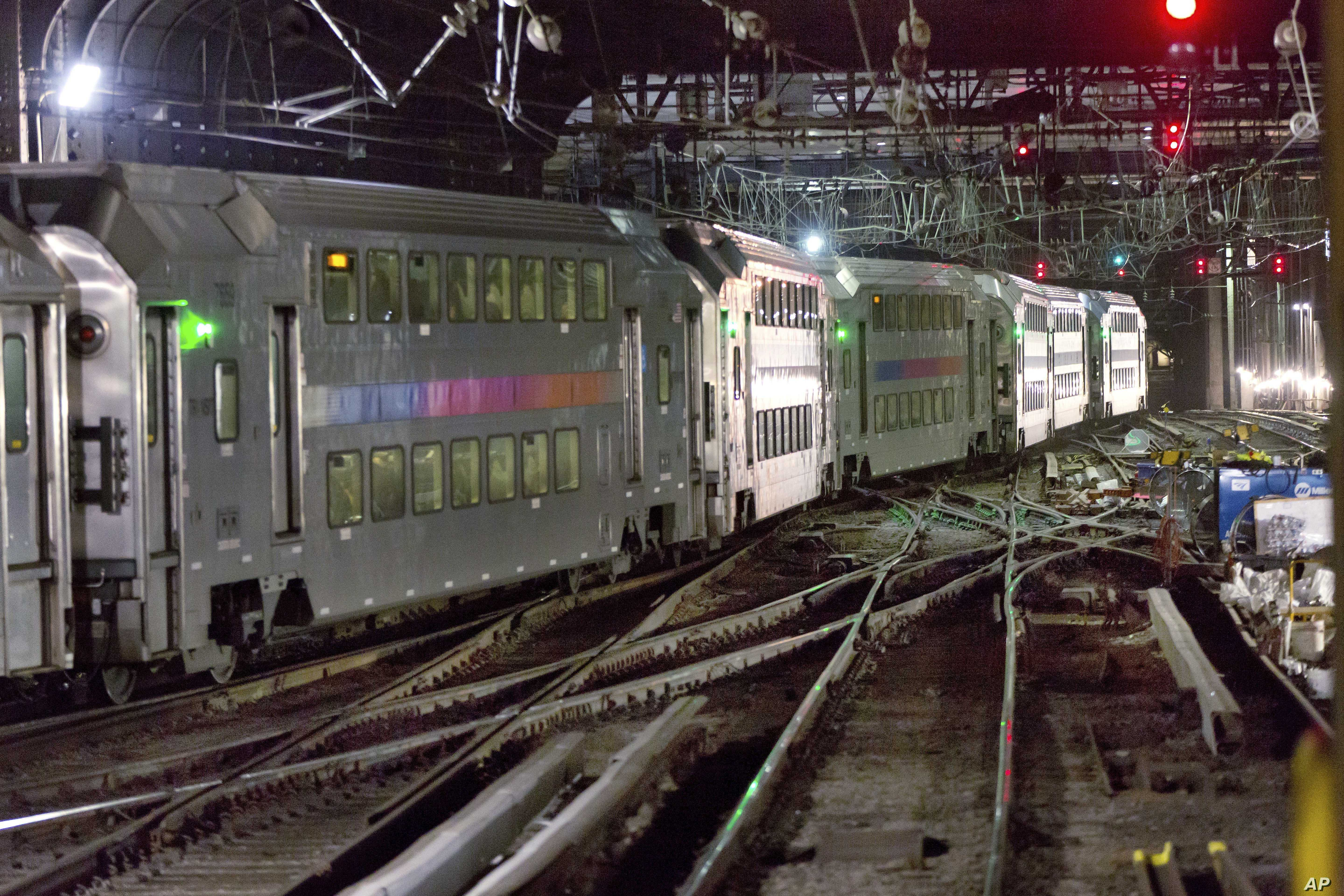 FILE - A New Jersey Transit train traverses the tracks in New York's Penn Station, July 25, 2017. President Donald Trump opposes funding for a Hudson River tunnel and rail project that's important to Senate Minority Leader Chuck Schumer, a New York D...