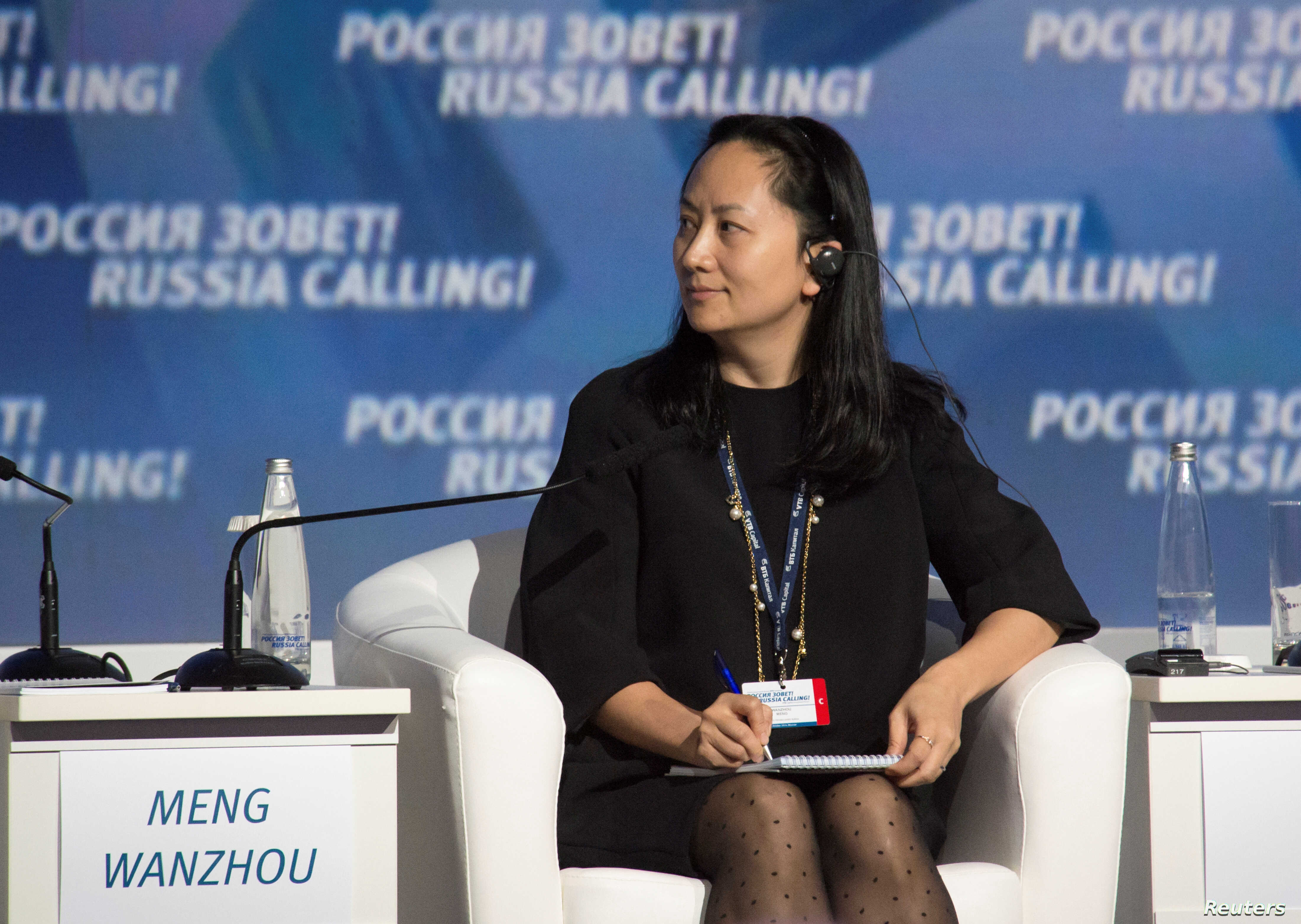 """FILE - Meng Wanzhou, executive board director of the Chinese technology giant Huawei, attends a session of the VTB Capital Investment Forum """"Russia Calling!"""" in Moscow, Russia Oct. 2, 2014."""